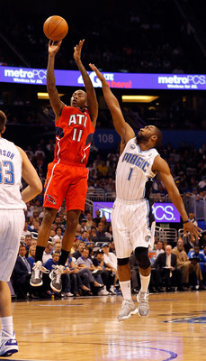 ORLANDO, FL - APRIL 16:  Jamal Crawford #11 of the Atlanta Hawks shoots over Gilbert Arenas #1 of the Orlando Magic during Game One of the Eastern Conference Quarterfinals of the 2011 NBA Playoffs on April 16, 2011 at the Amway Arena in Orlando, Florida.
