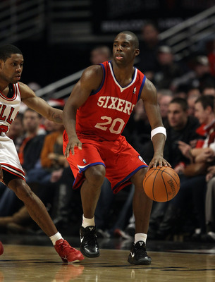CHICAGO, IL - DECEMBER 21: Jodie Meeks #20 of the Philadelphia 76ers moves against C.J. Watson #32 of the Chicago Bulls at the United Center on December 21, 2010 in Chicago, Illinois. The Bulls defeated the 76ers 121-76. NOTE TO USER: User expressly ackno