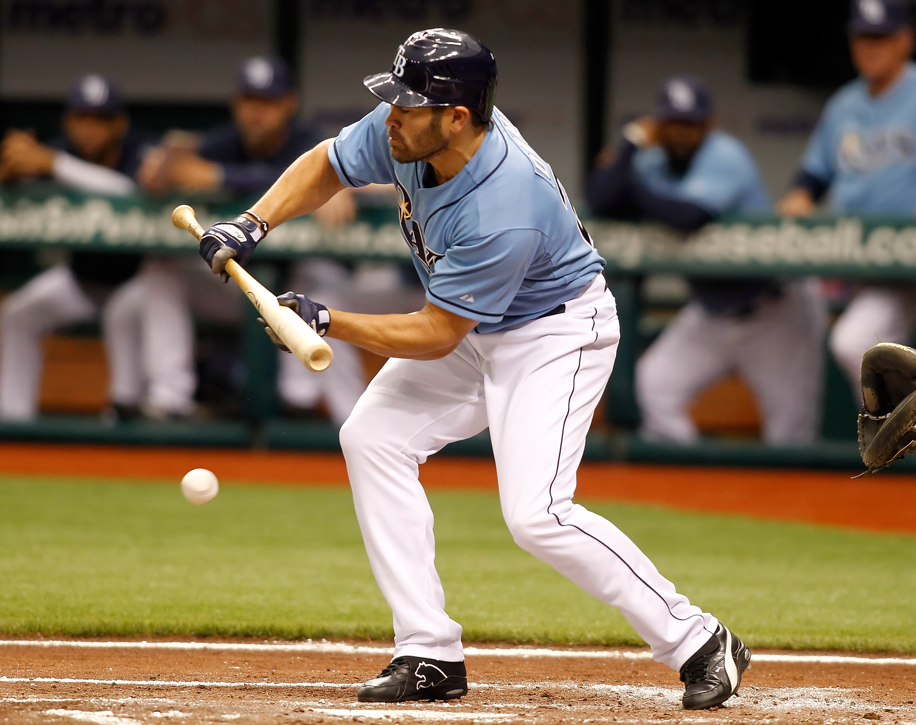 ST. PETERSBURG, FL - APRIL 17:  Outfielder Johnny Damon #22 of the Tampa Bay Rays attempts a bunt against the Minnesota Twins during the game at Tropicana Field on April 17, 2011 in St. Petersburg, Florida.  (Photo by J. Meric/Getty Images)