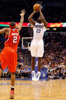 ORLANDO, FL - APRIL 19:  Jason Richardson #23 of the Orlando Magic shoots over Joe Johnson #2 of the Atlanta Hawks of the Orlando Magic during Game Two of the Eastern Conference Quarterfinals of the 2011 NBA Playoffs on April 19, 2011 at the Amway Arena i