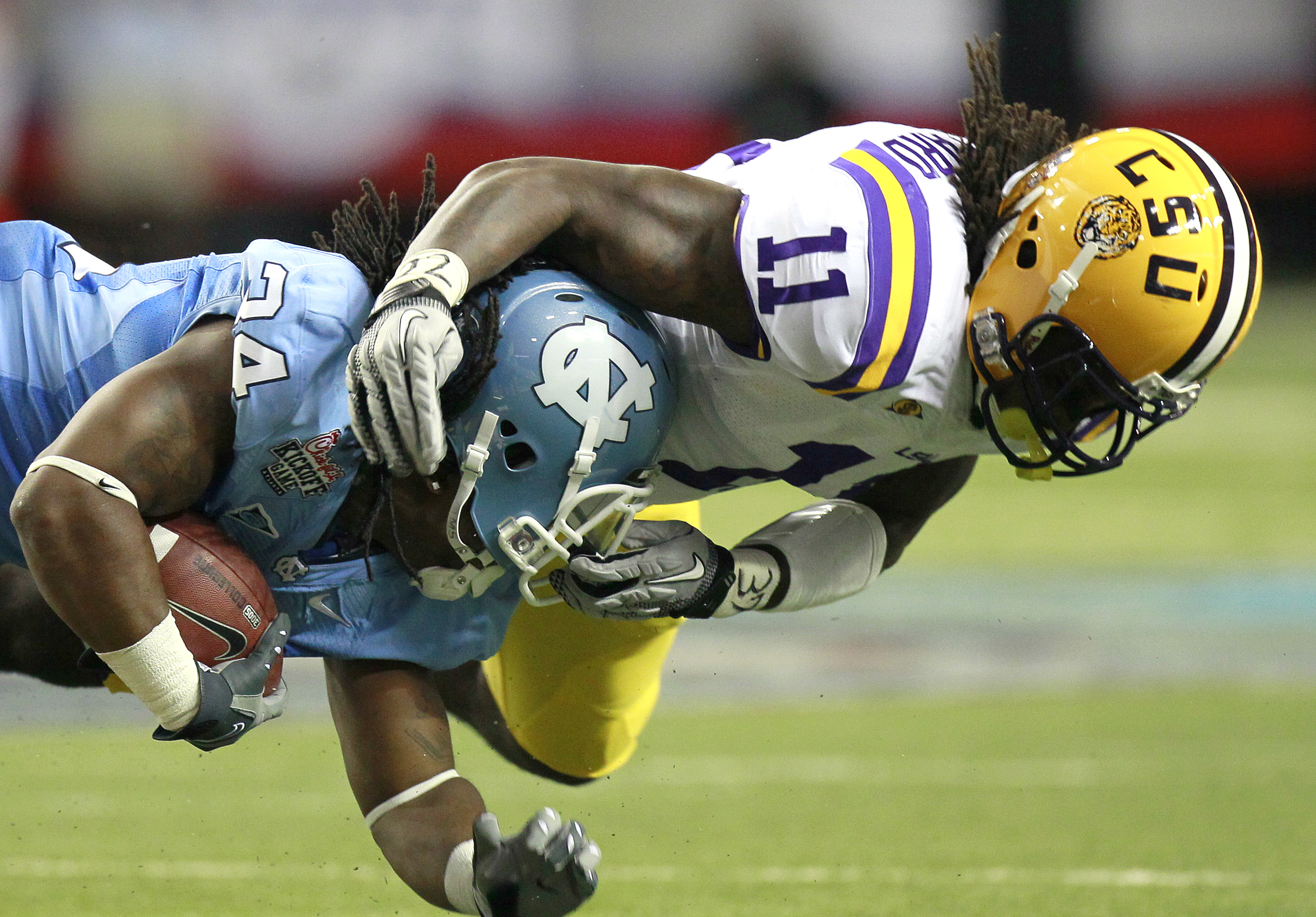 ATLANTA - SEPTEMBER 4: Kelvin Sheppard #11 of the LSU Tigers tackles Johnny White #34 of the North Carolina Tar Heels at the Georgia Dome September 4, 2010 in Atlanta, Georgia.  (Photo by Kevin C. Cox/Getty Images)