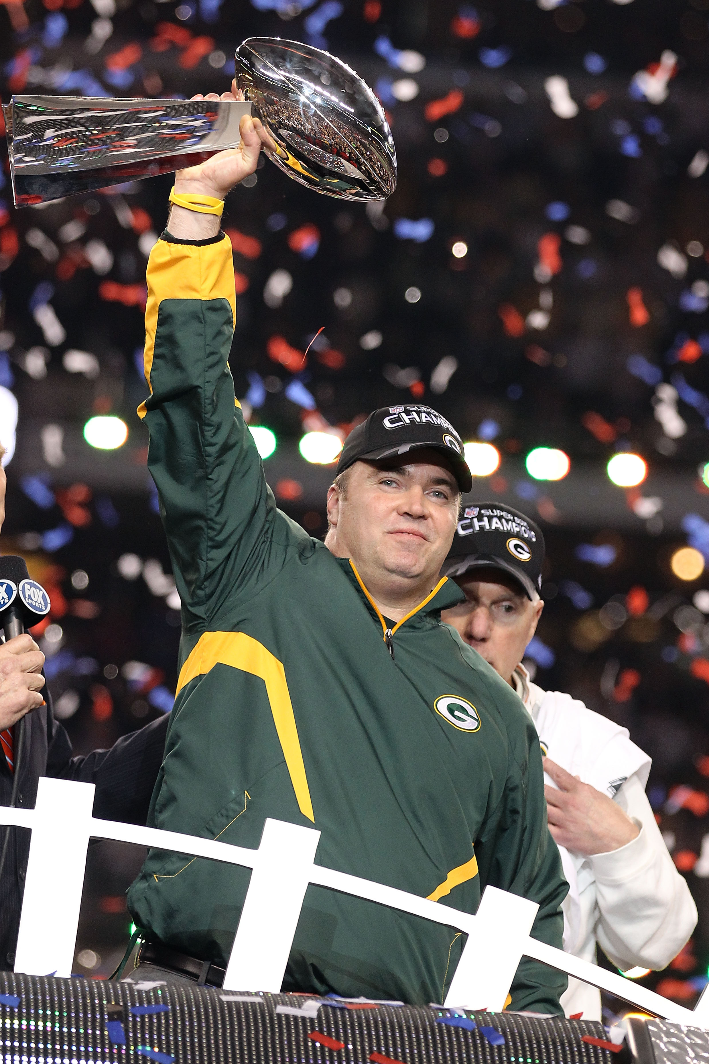 ARLINGTON, TX - FEBRUARY 06: Head coach Mike McCarthy of the Green Bay Packers holds up the Vince Lombardi Trophy after winning Super Bowl XLV 31-25 against the Pittsburgh Steelers at Cowboys Stadium on February 6, 2011 in Arlington, Texas.  (Photo by Al