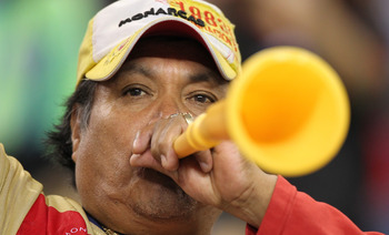 SEATTLE - OCTOBER 12:  A fan of Chivas de Guadalajara blows a vuvuzela during the game against the Seattle Sounders FC on October 12, 2010 at Qwest Field in Seattle, Washington. The Sounders defeated Chivas de Guadalajara 3-1. (Photo by Otto Greule Jr/Get