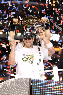 ARLINGTON, TX - FEBRUARY 06: Super Bowl MVP Aaron Rodgers #12 of the Green Bay Packers holds up the Vince Lombardi Trophy as Clay Matthews #52 holds up a championship belt after winning Super Bowl XLV 31-25 against the Pittsburgh Steelers at Cowboys Stadi