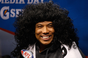 ARLINGTON, TX - FEBRUARY 01:  Hines Ward #86 of the Pittsburgh Steelers smiles as he wears a Troy Polamalu wig as he is on the podium during Super Bowl XLV Media Day ahead of Super Bowl XLV at Cowboys Stadium on February 1, 2011 in Arlington, Texas. The P