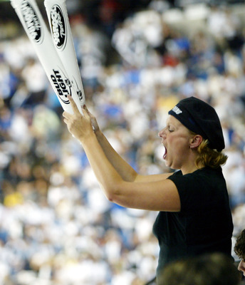 TAMPA, FL - MAY 27:  A Tampa Bay Lightning fan cheers using thundersticks in the third period against the Calgary Flames in game two of the NHL Stanley Cup Finals on May 27, 2004 at the St. Pete Times Forum in Tampa, Florida.  (Photo by Doug Pensinger/Get