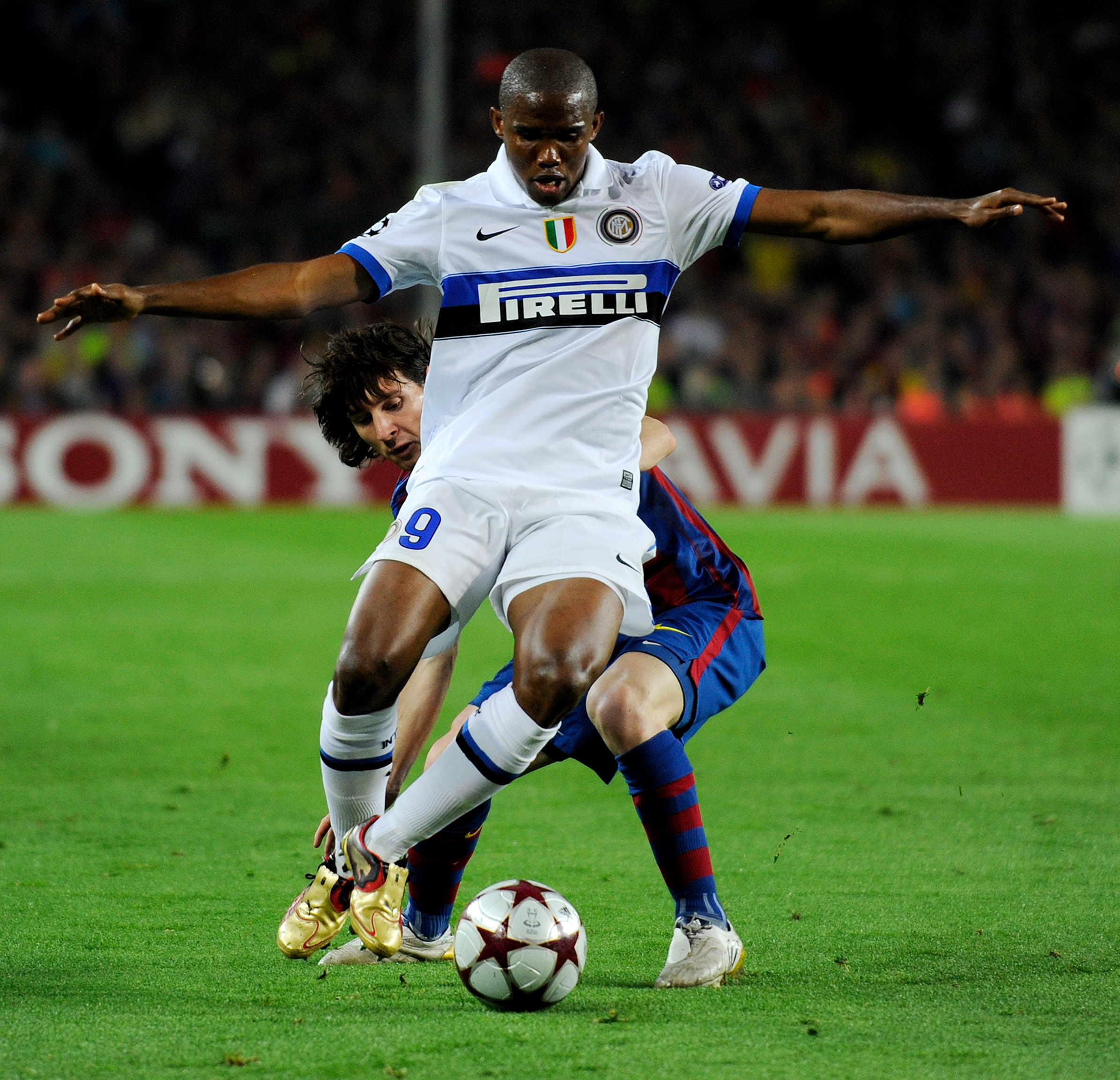 Samuel Eto'o holds off a challenge by Lionel Messi in the 2010 Champions League semi-final