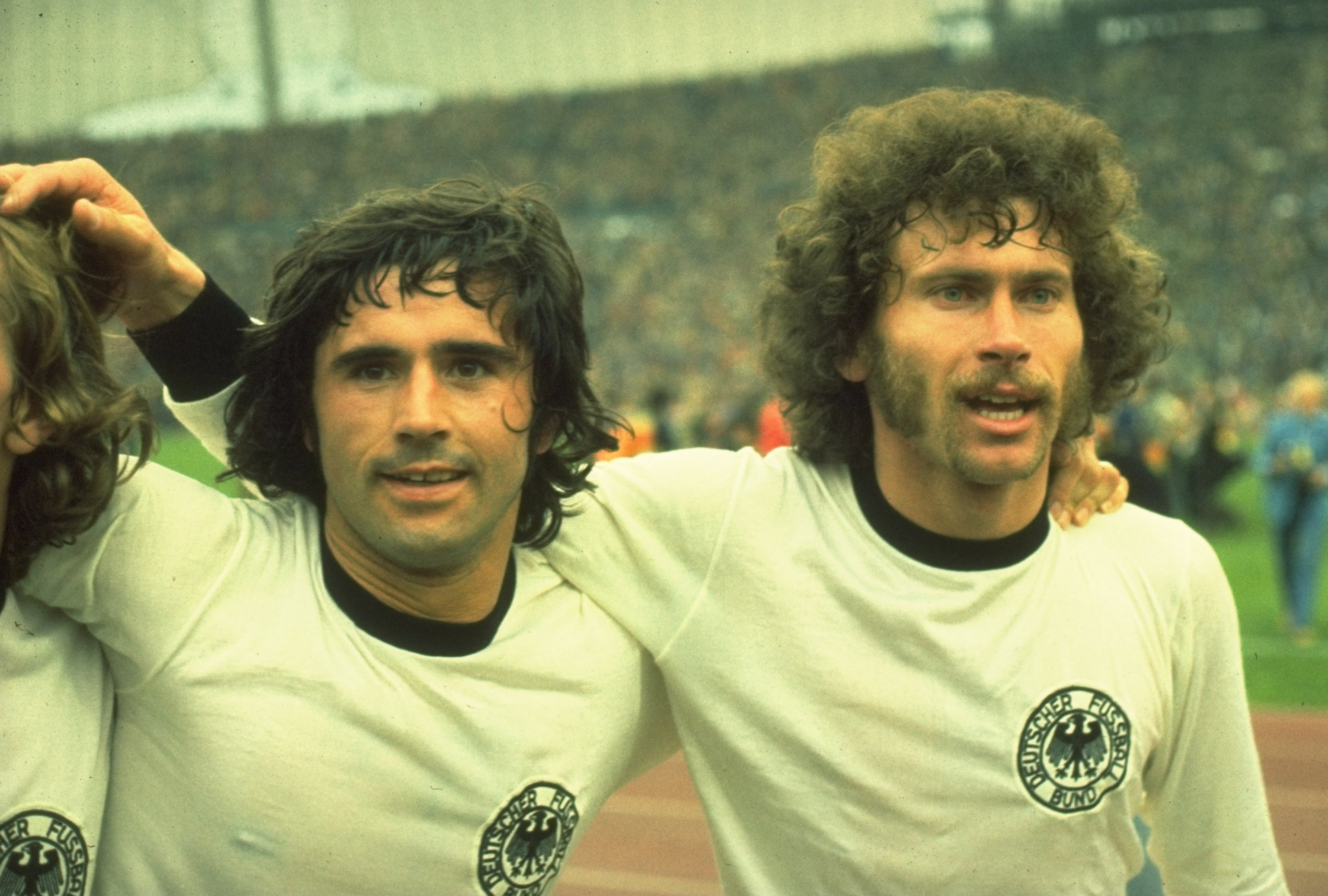 Gerd Müller on the left, celebrates the 1974 World Cup win with Paul Breitner