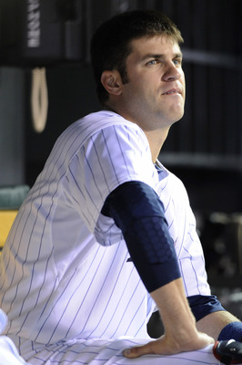 MINNEAPOLIS, MN - APRIL 9: Joe Mauer #7 of the Minnesota Twins in the dugout during the seventh inning of their game against the Oakland Athletics on April 9, 2011 at Target Field in Minneapolis, Minnesota. Athletics defeated the Twins 1-0. (Photo by Hann