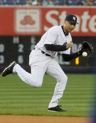 NEW YORK, NY - APRIL 16:  Derek Jeter #2 of the New York Yankees fields the ball against the Texas Rangers on April 16, 2011 at Yankee Stadium in the Bronx borough of New York City. The Yankees defeated the Rangers 5-2.  (Photo by Jim McIsaac/Getty Images