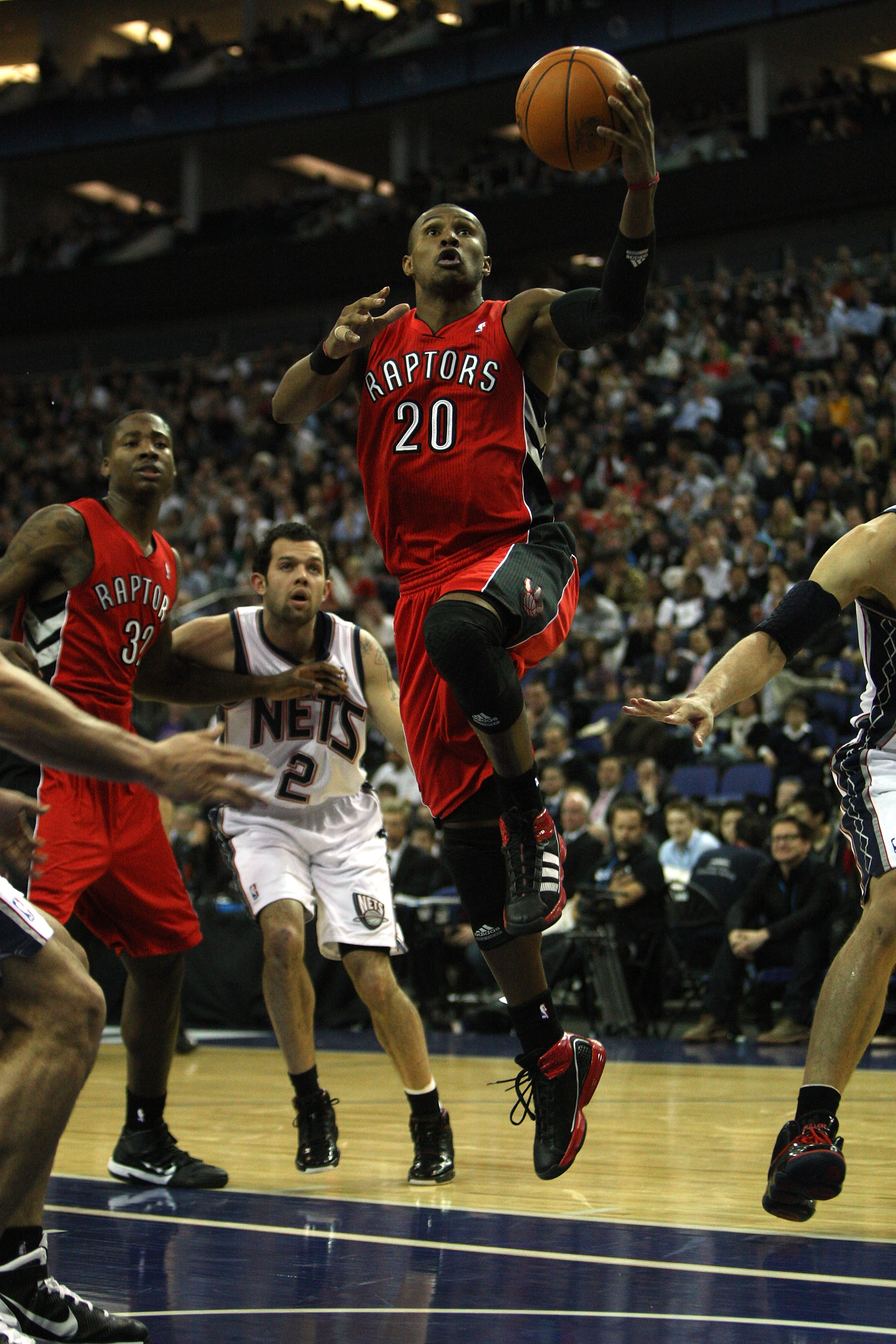 LONDON, ENGLAND - MARCH 04:  #20 Leandro Barbosa of the Raptors scores during the NBA match between New Jersey Nets and the Toronto Raptors at the O2 Arena on March 4, 2011 in London, England. NOTE TO USER: User expressly acknowledges and agrees that, by