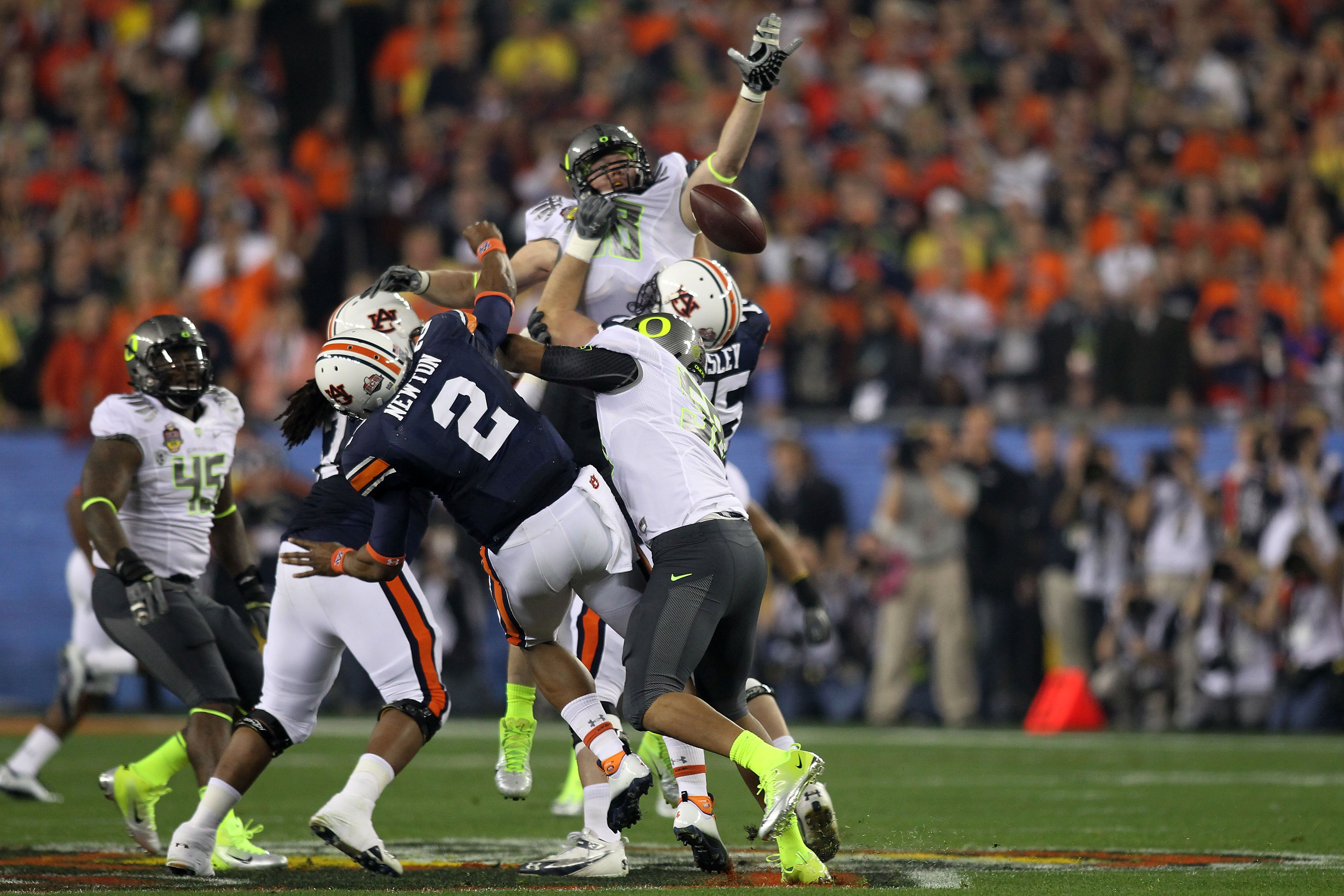 GLENDALE, AZ - JANUARY 10:  Cameron Newton #2 of the Auburn Tigers has a pass blocked by the Oregon Ducks during the Tostitos BCS National Championship Game at University of Phoenix Stadium on January 10, 2011 in Glendale, Arizona.  (Photo by Jonathan Fer