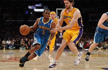 LOS ANGELES, CA - APRIL 20:  Chris Paul #3 of the New Orleans Hornets drives on Pau Gasol #16 of the Los Angeles Lakers in Game Two of the Western Conference Quarterfinals in the 2011 NBA Playoffs on April 20, 2011 at Staples Center in Los Angeles, Califo