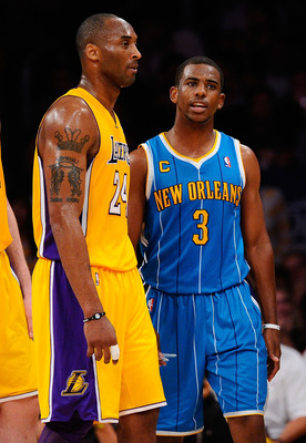 LOS ANGELES, CA - APRIL 20:  Kobe Bryant #24 of the Los Angeles Lakers stands next to Chris Paul #3 of the New Orleans Hornets in Game Two of the Western Conference Quarterfinals in the 2011 NBA Playoffs on April 20, 2011 at Staples Center in Los Angeles,