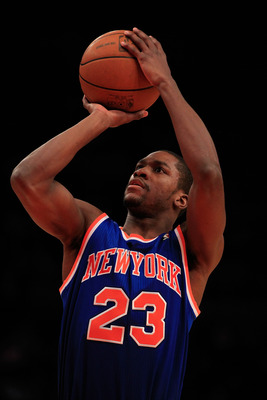 NEW YORK, NY - FEBRUARY 16: Toney Douglas #23 of the New York Knicks shoots a free throw against the Atlanta Hawks at Madison Square Garden on February 16, 2011 in New York City. NOTE TO USER: User expressly acknowledges and agrees that, by downloading an