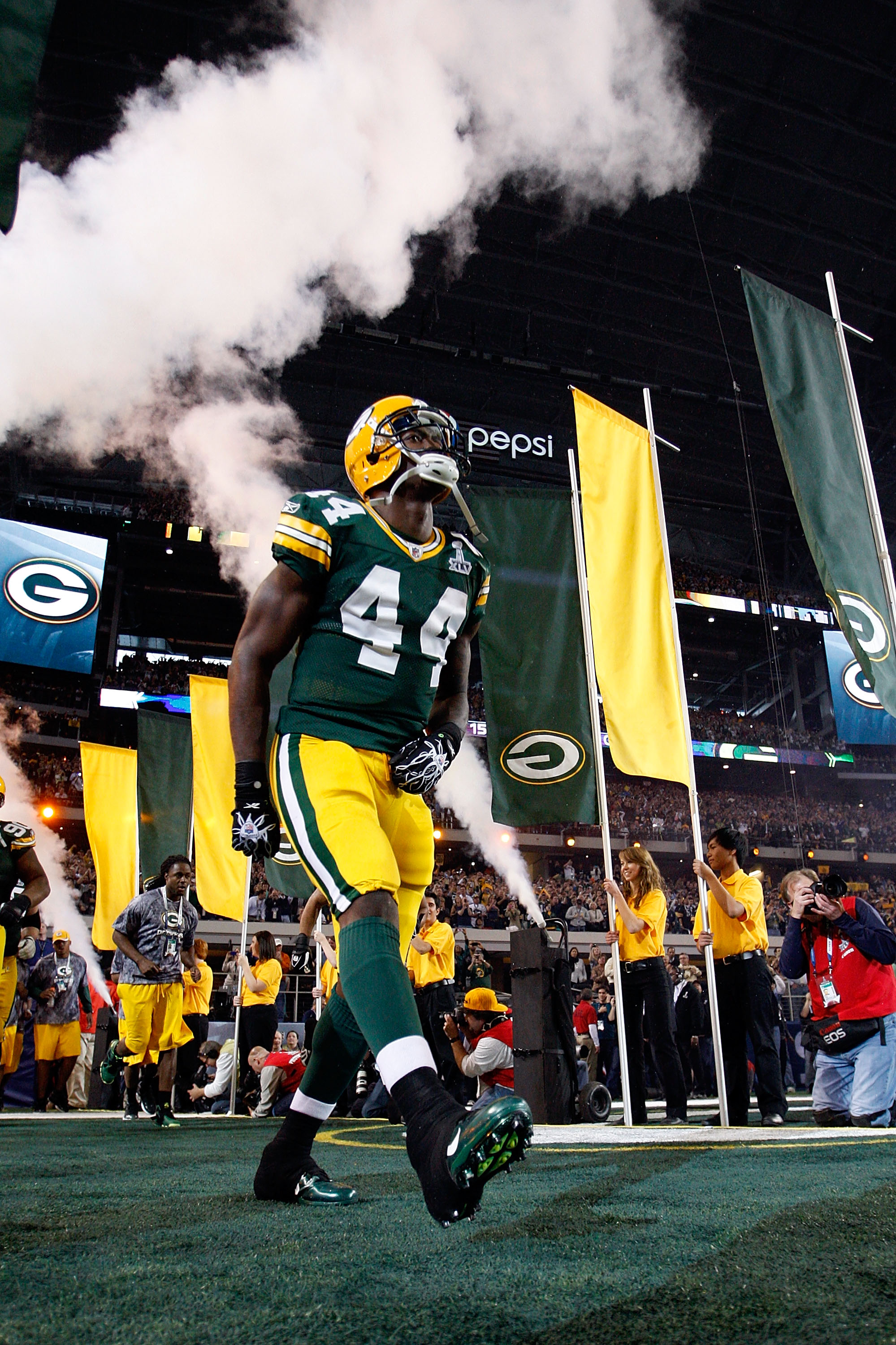 ARLINGTON, TX - FEBRUARY 06:  James Starks #44 of the Green Bay Packers runs onto the field during pregame introductions and festivities against the Pittsburgh Steelers during Super Bowl XLV at Cowboys Stadium on February 6, 2011 in Arlington, Texas.  (Ph