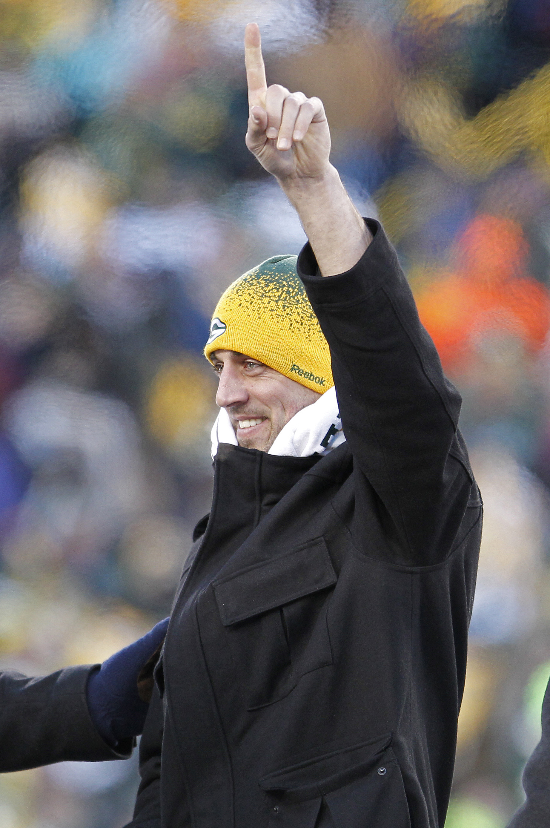 GREEN BAY, WI - FEBRUARY 08:  Green Bay Packers quarterback Aaron Rodgers address fans during the Packers victory ceremony at Lambeau Field on February 8, 2011 in Green Bay, Wisconsin.  (Photo by Matt Ludtke/Getty Images)