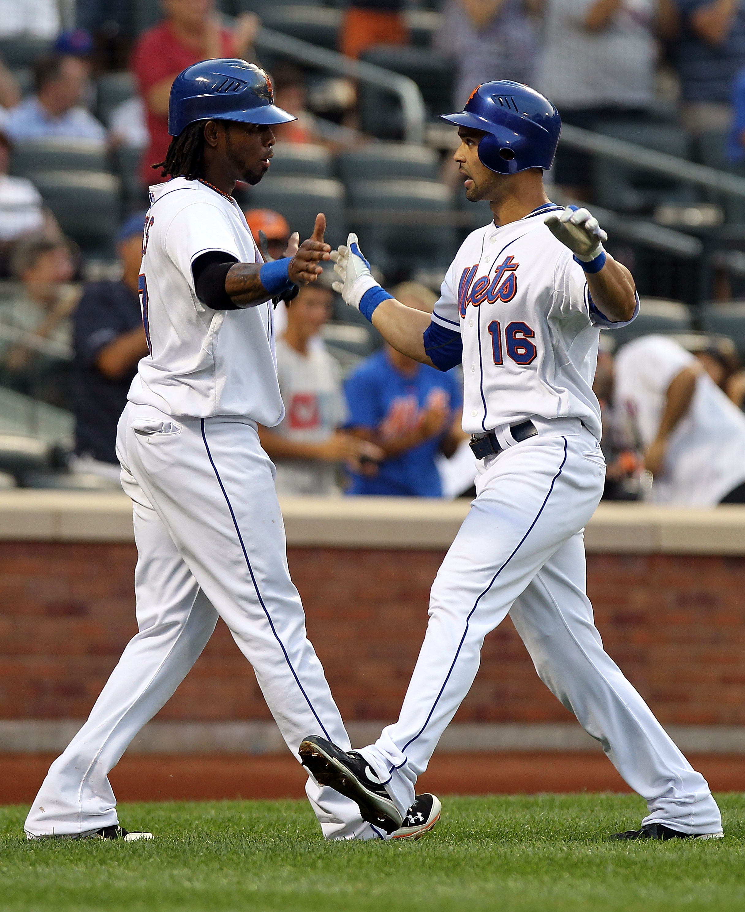 NEW YORK - AUGUST 11:  Angel Pagan #16 of the New York Mets is congratulated by scoring teammate Jose Reyes after a two run home run in the first inning against the Colorado Rockies at Citi Field on August 11, 2010 in the Flushing neighborhood of the Quee