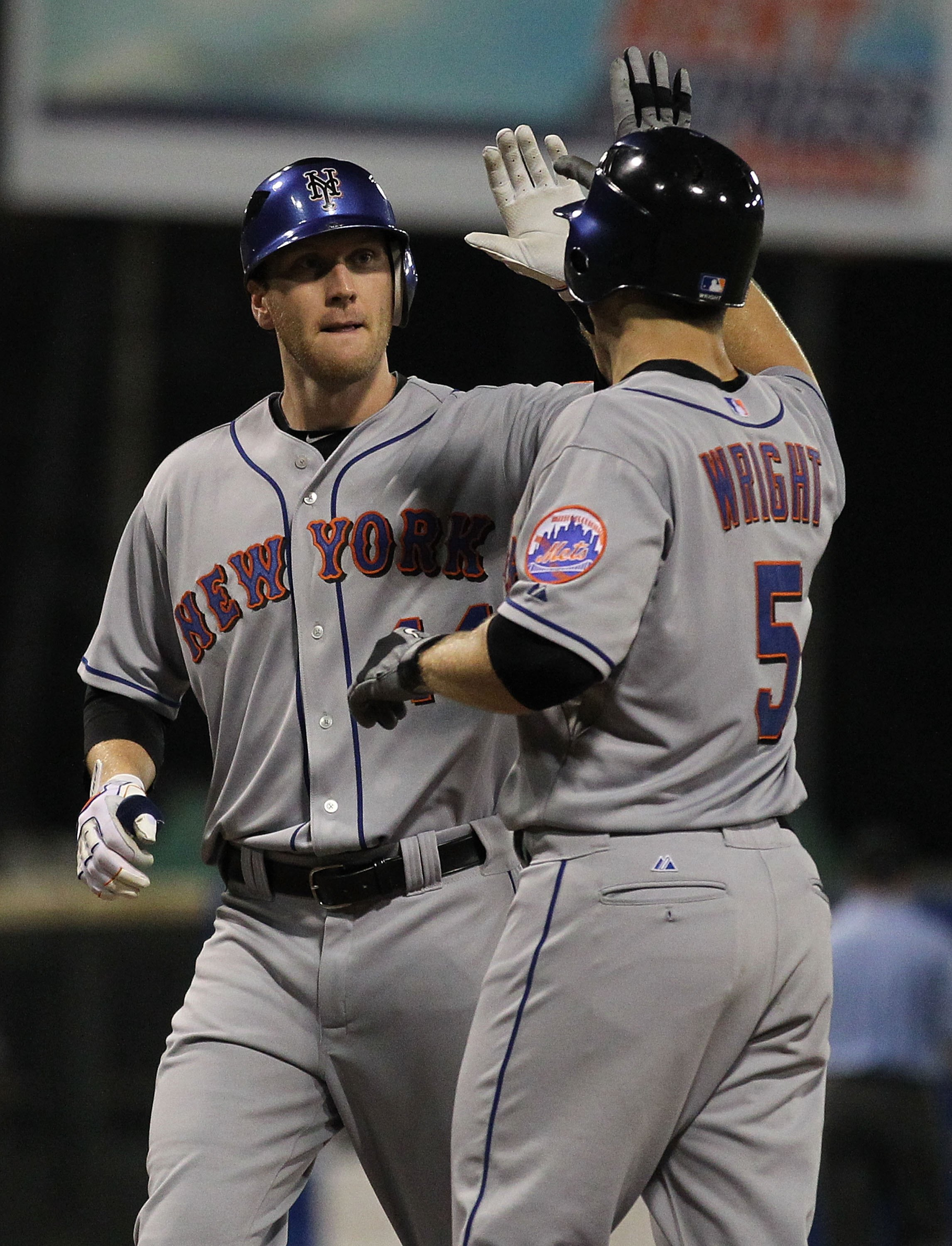 SAN JUAN, PUERTO RICO - JUNE 28:  Jason Bay #44 of the New York Mets is greeted by David Wright #5 after hitting a home run against the Florida Marlins  during their game at Hiram Bithorn Stadium on June 28, 2010 in San Juan, Puerto Rico.  (Photo by Al Be