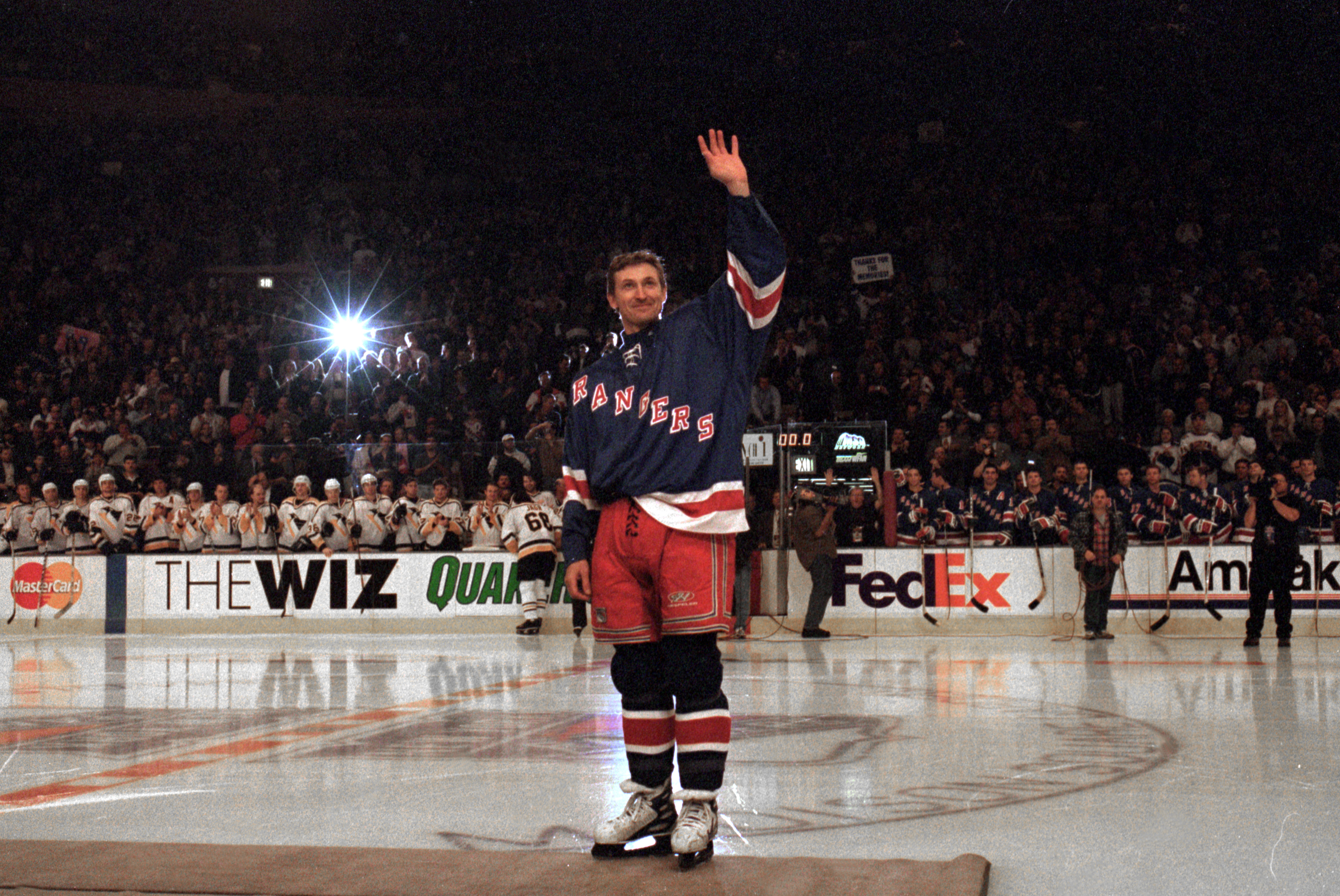 NEW YORK, NY - APRIL 18:  Wayne Gretzky #99 of the New York Rangers acknowledges the crowd during introductions before playing in his final career game against the Pittsburgh Penguins at the Madison Square Garden on April 18, 1999 in New York City, New Yo