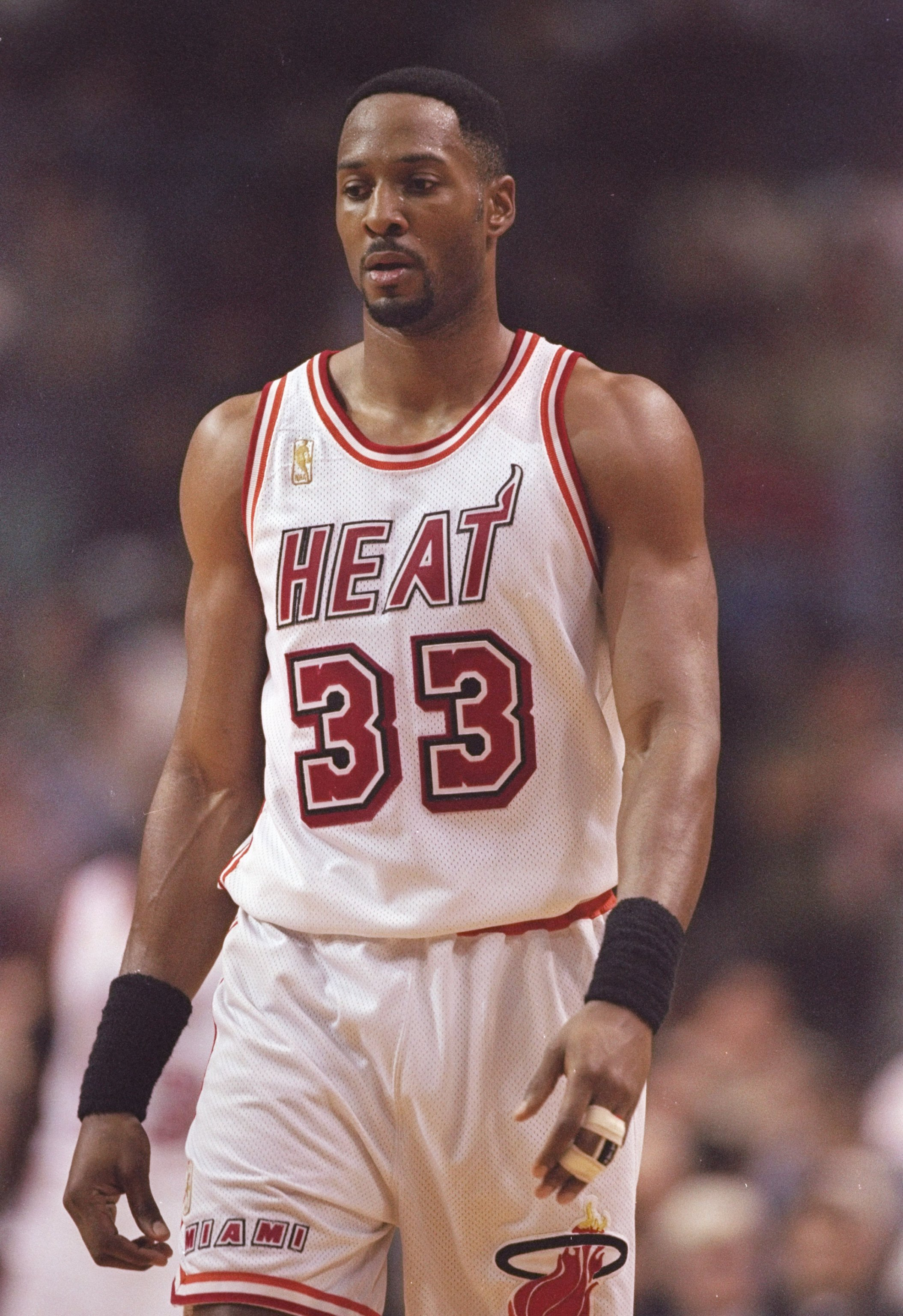 b41dd64ff596f 19 Dec 1996  Center Alonzo Mourning of the Miami Heat stands on the court  during