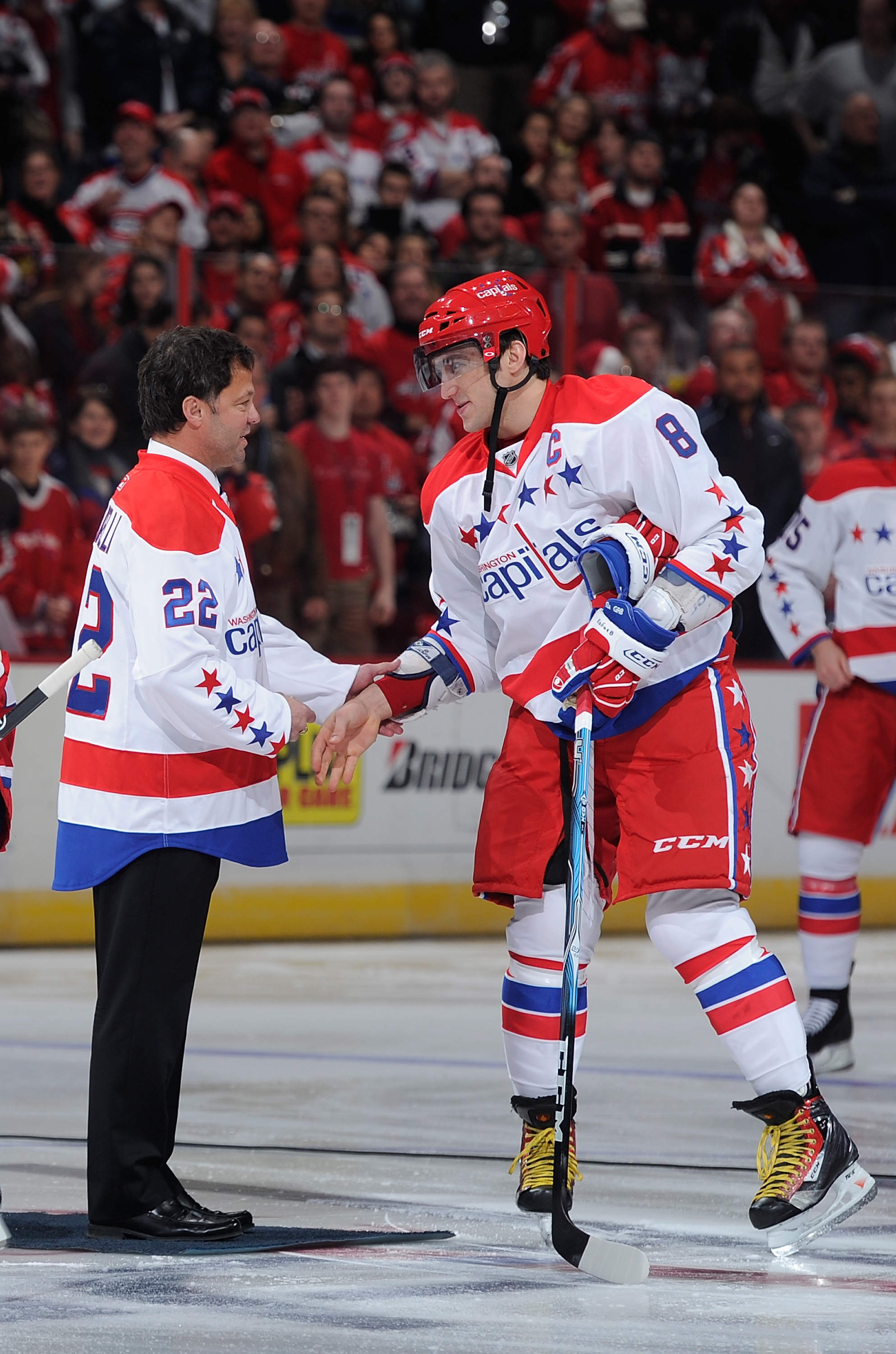 WASHINGTON, DC - FEBRUARY 01:  Former Washington Capital Dino Ciccarelli shakes hands with Alex Ovechkin #8 of the Washington Capitals before the game against the Montreal Canadiens at the Verizon Center on February 1, 2011 in Washington, DC.  (Photo by G