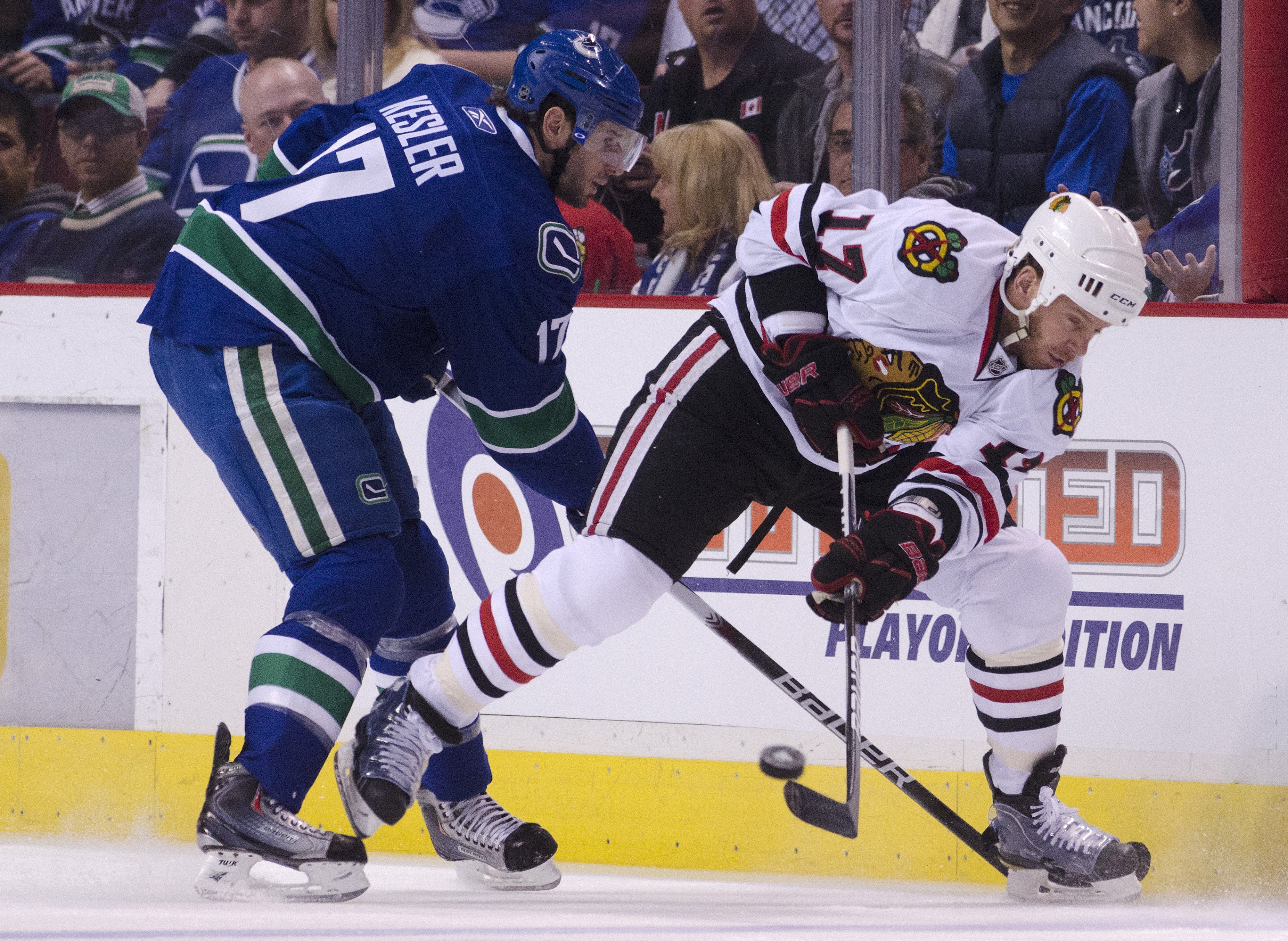 VANCOUVER, CANADA - APRIL 21: Ryan Kesler #17 of the Vancouver Canucks checks Ryan Johnson #17 of the Chicago Blackhawks as he clear the puck during the first period in Game Five of the Western Conference Quarterfinals during the 2011 NHL Stanley Cup Play