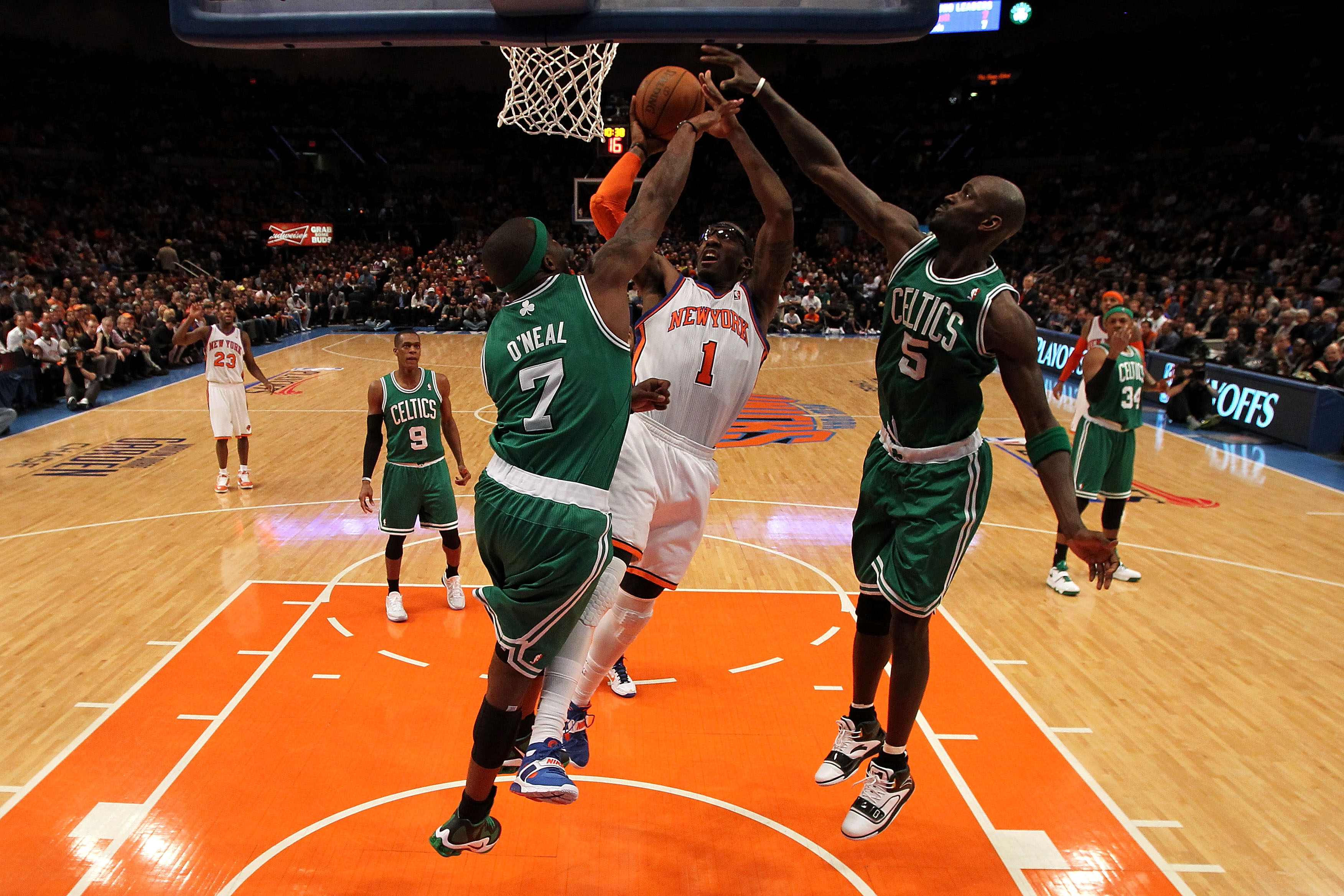 NEW YORK, NY - APRIL 22:  Amar'e Stoudemire #1 of the New York Knicks drives for a shot attempt against Jermaine O'Neal #7 and Kevin Garnett #5 of the Boston Celtics in Game Three of the Eastern Conference Quarterfinals in the 2011 NBA Playoffs on April 2