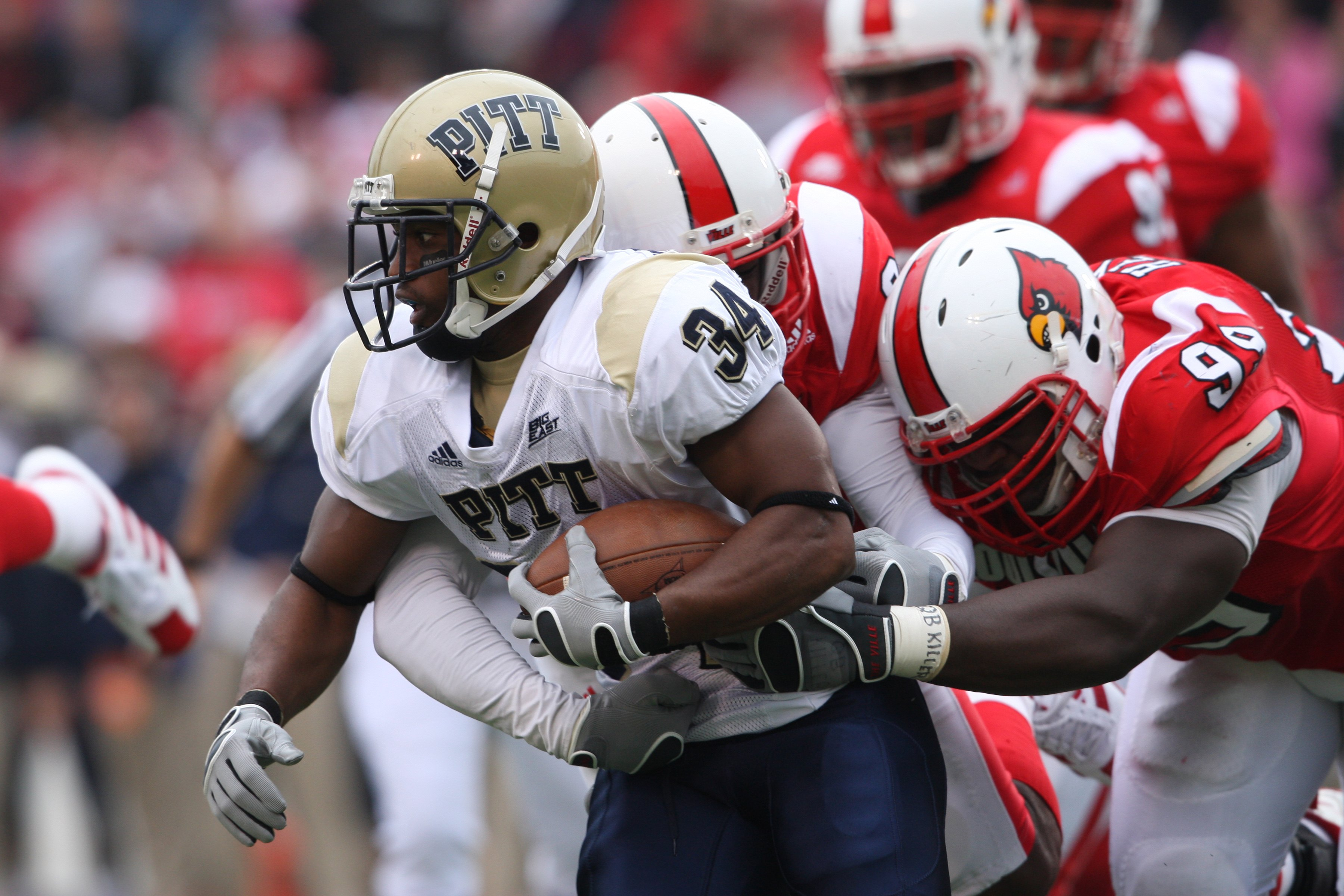 LOUISVILLE - OCTOBER 27:  LaRod Stephens-Howling #34 of the Pittsburgh Panthers is tackled during the game against the Louisville Cardinals at Papa John?s Cardinal Stadium on October 27, 2007 in Louisville, Kentucky. (Photo by Andy Lyons/Getty Images)