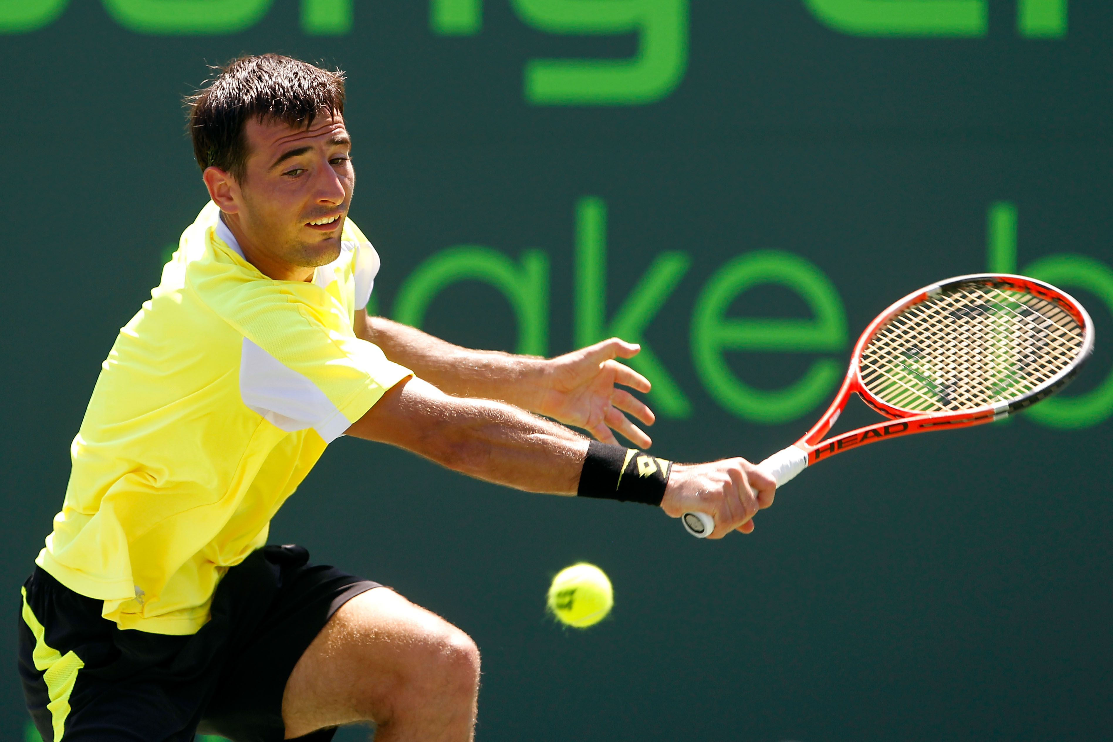 KEY BISCAYNE, FL - MARCH 25:  Ivan Dodig of Crotia hits a return against Robin Soderling of Sweden during the Sony Ericsson Open at Crandon Park Tennis Center on March 25, 2011 in Key Biscayne, Florida.  (Photo by Matthew Stockman/Getty Images)