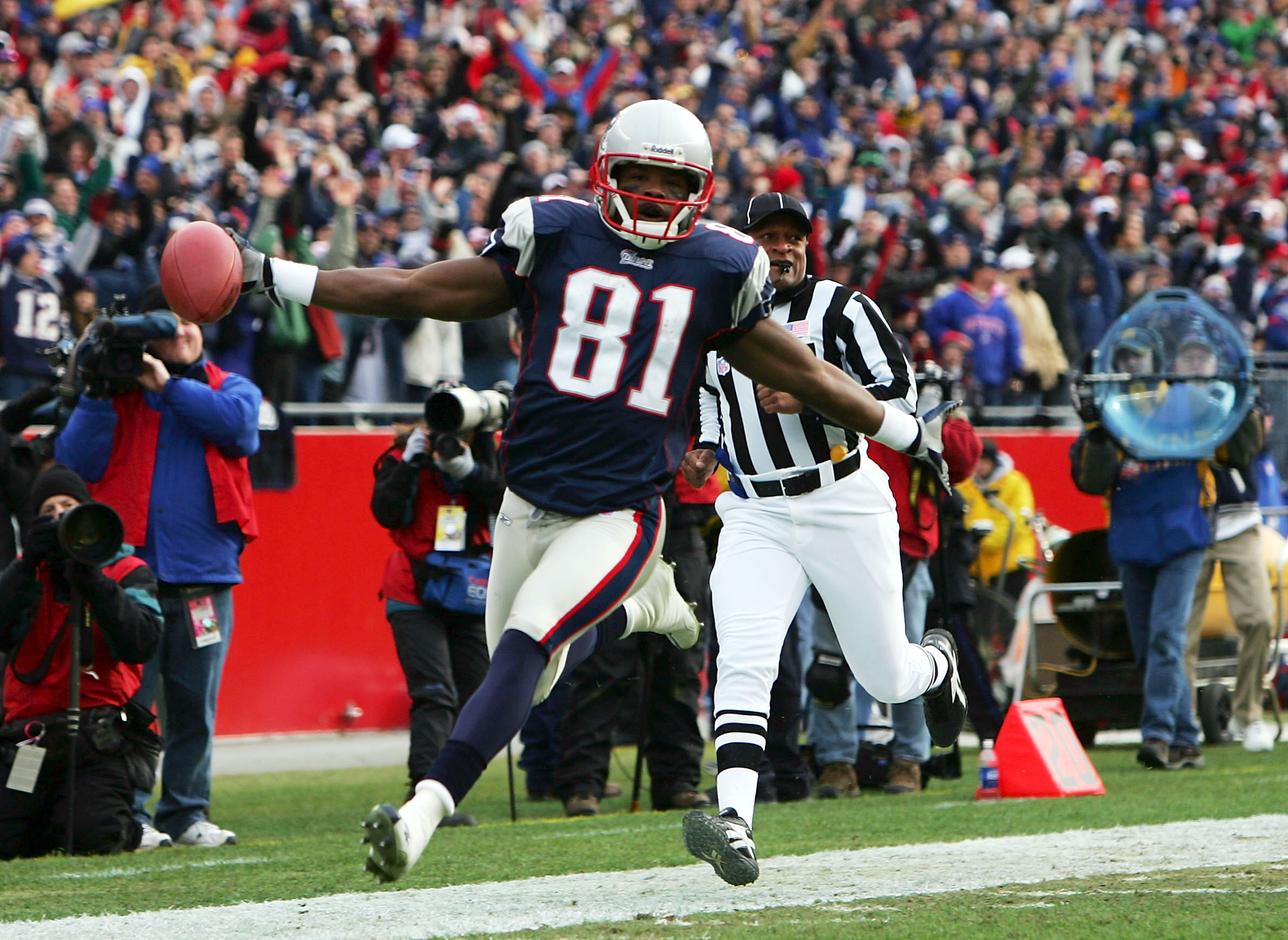 FOXBORO, MA - JANUARY 2:  Bethel Johnson #81 of the New England Patriots celebrates a punt return touchdown which was called back due to a penalty in the first quarter against the San Francisco 49ers during their game on January 2, 2005 at Gillette Stadiu