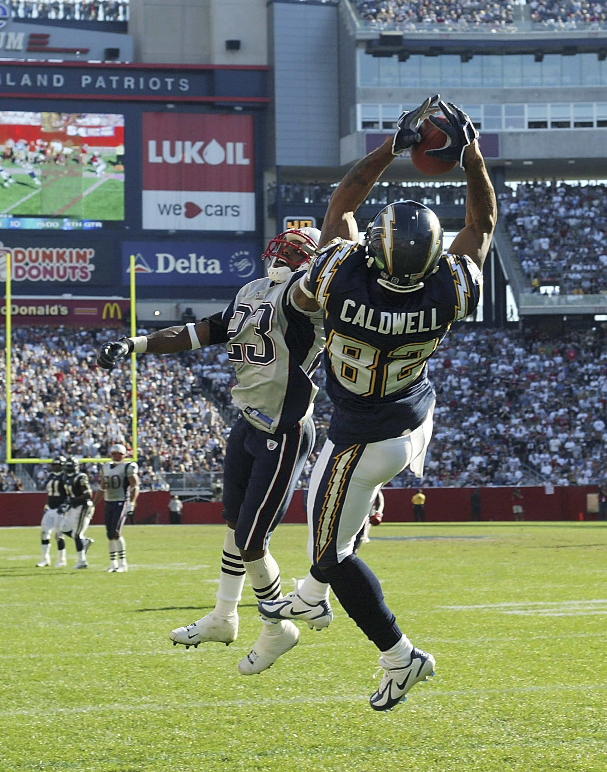 FOXBORO, MA - OCTOBER 2:  Wide receiver Reche Caldwell #82 of the San Diego Chargers catches a 28-yard touchdown pass against cornerback Duane Starks #23 of the New England Patriots in the third quarter on October 2, 2005 at Gillette Stadium in Foxboro, M
