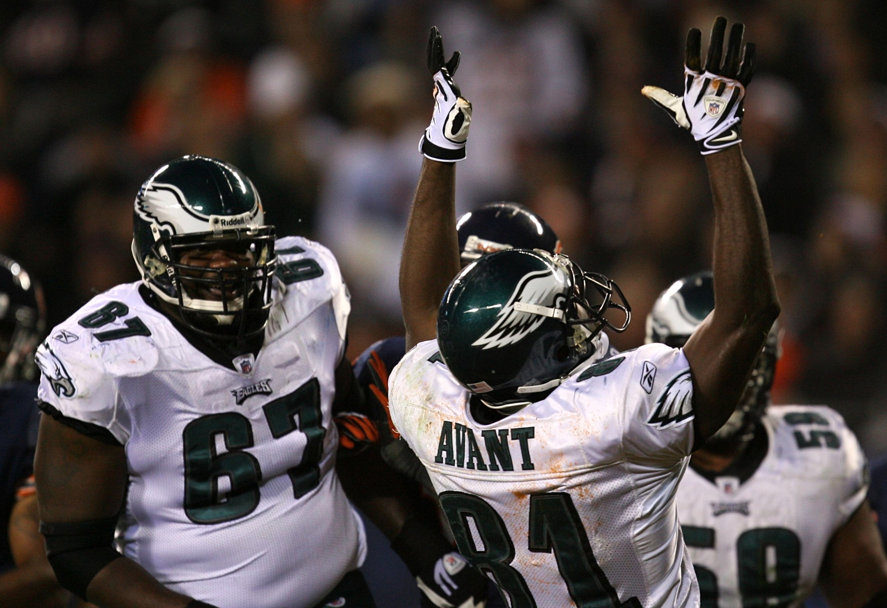 CHICAGO - NOVEMBER 22: Jamaal Jackson #67 and Jason Avant #81 of the Philadelphia Eagles celebrate after Avant scored a 13-yard touchdown reception in the first quarter against the Chicago Bears at Soldier Field on November 22, 2009 in Chicago, Illinois.