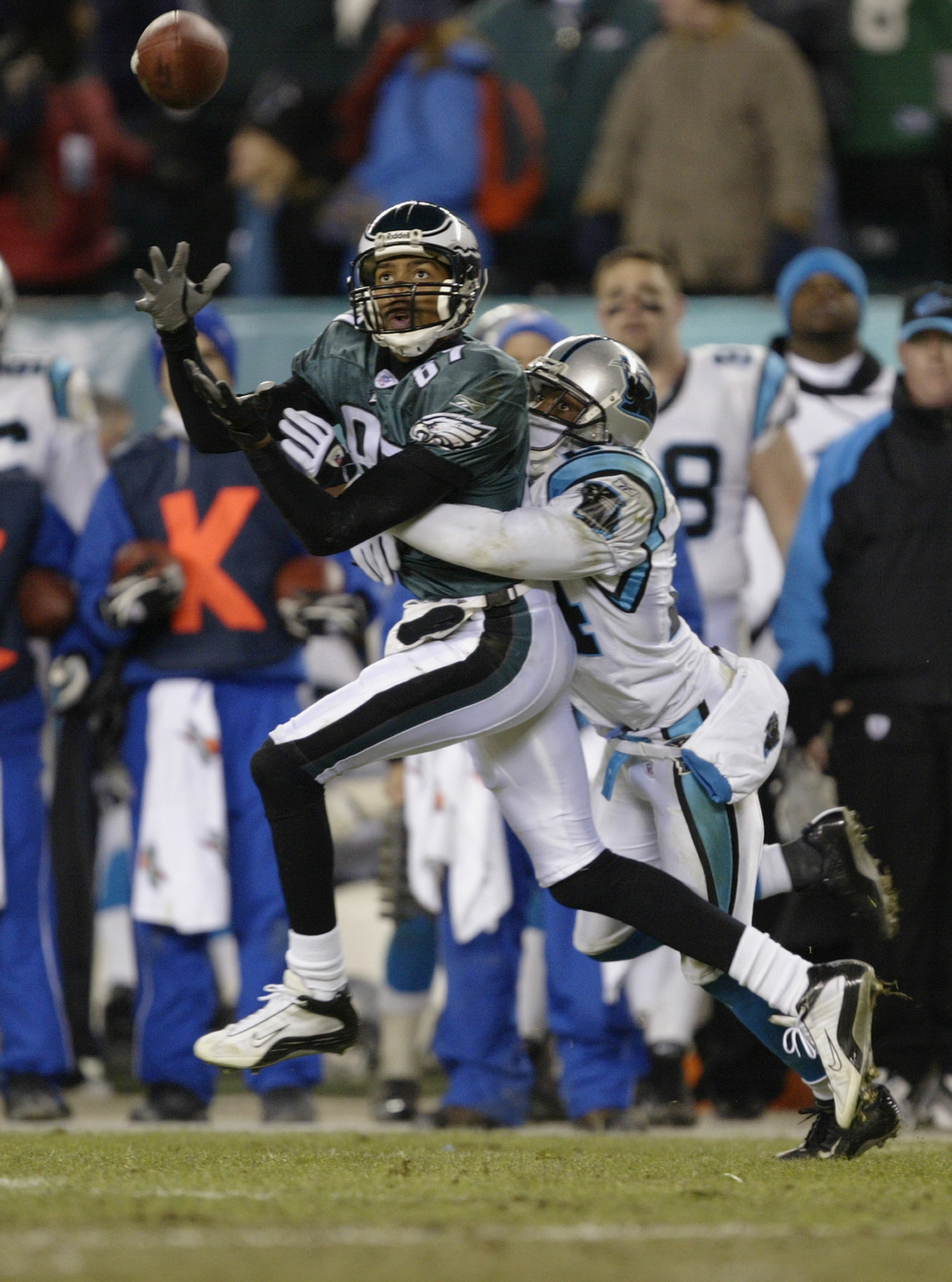 PHILADELPHIA - JANUARY 18:  Wide receiver Freddie Mitchell #84 of the Philadelphia Eagles goes out for a pass and is covered by Ricky Manning Jr. #24 of the Carolina Panthers in the NFC Championship game on January 18, 2004 at Lincoln Financial Field in P