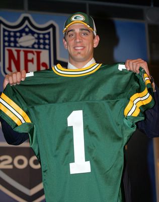 NEW YORK - APRIL 23:  Quarterback Aaron Rodgers (California) poses with his jersey after being drafted 24th overall by the Green Bay Packers during the 70th NFL Draft on April 23, 2005 at the Jacob K. Javits Convention Center in New York City.  (Photo by