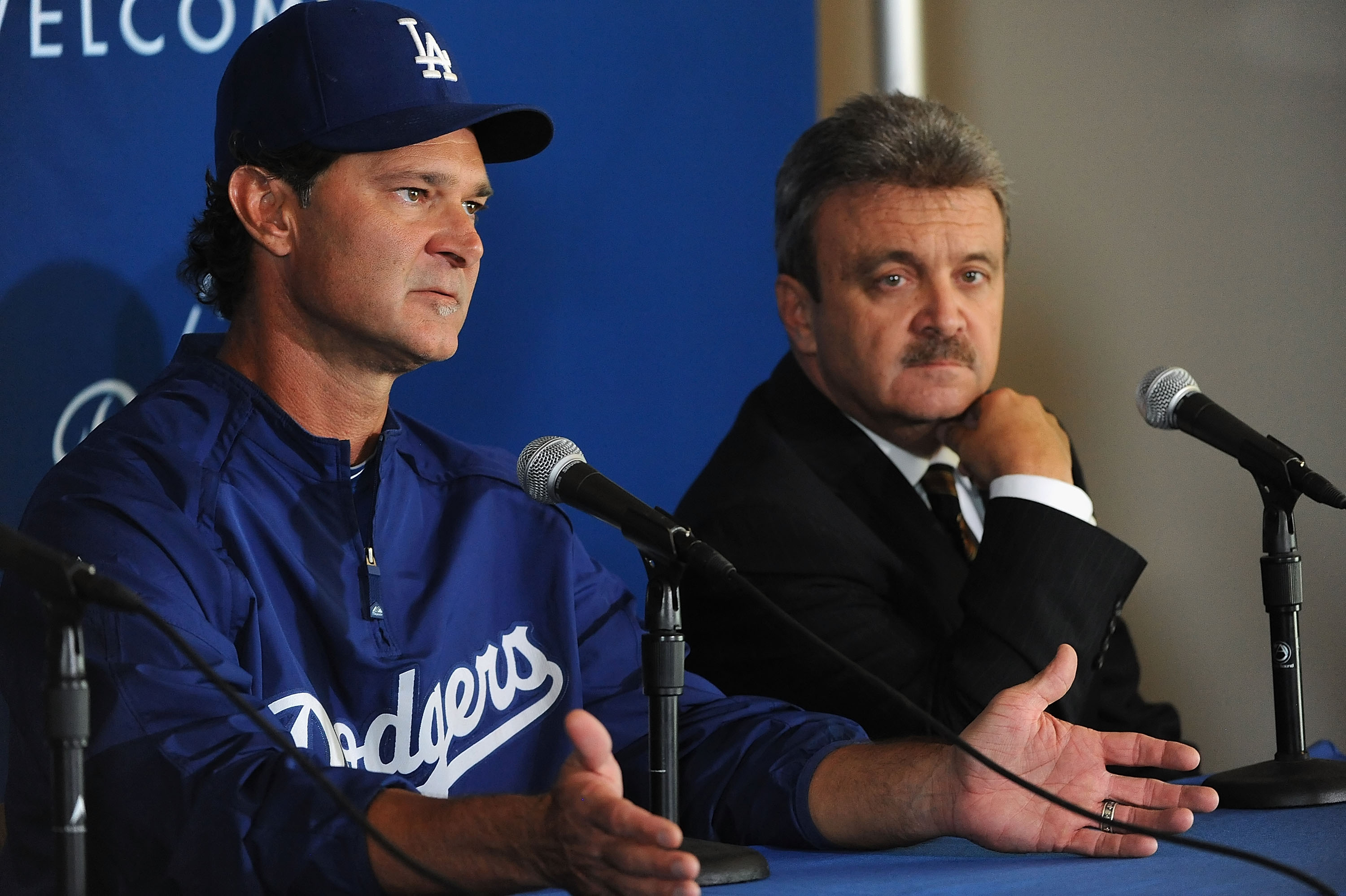 LOS ANGELES, CA - SEPTEMBER 17:  Coach Don Mattingly (L) and general manager Ned Colletti of the Los Angeles Dodgers attend a press conference announcing that Mattingly will manage the Dodgers in 2011 after Joe Torre retires at Dodger Stadium on September