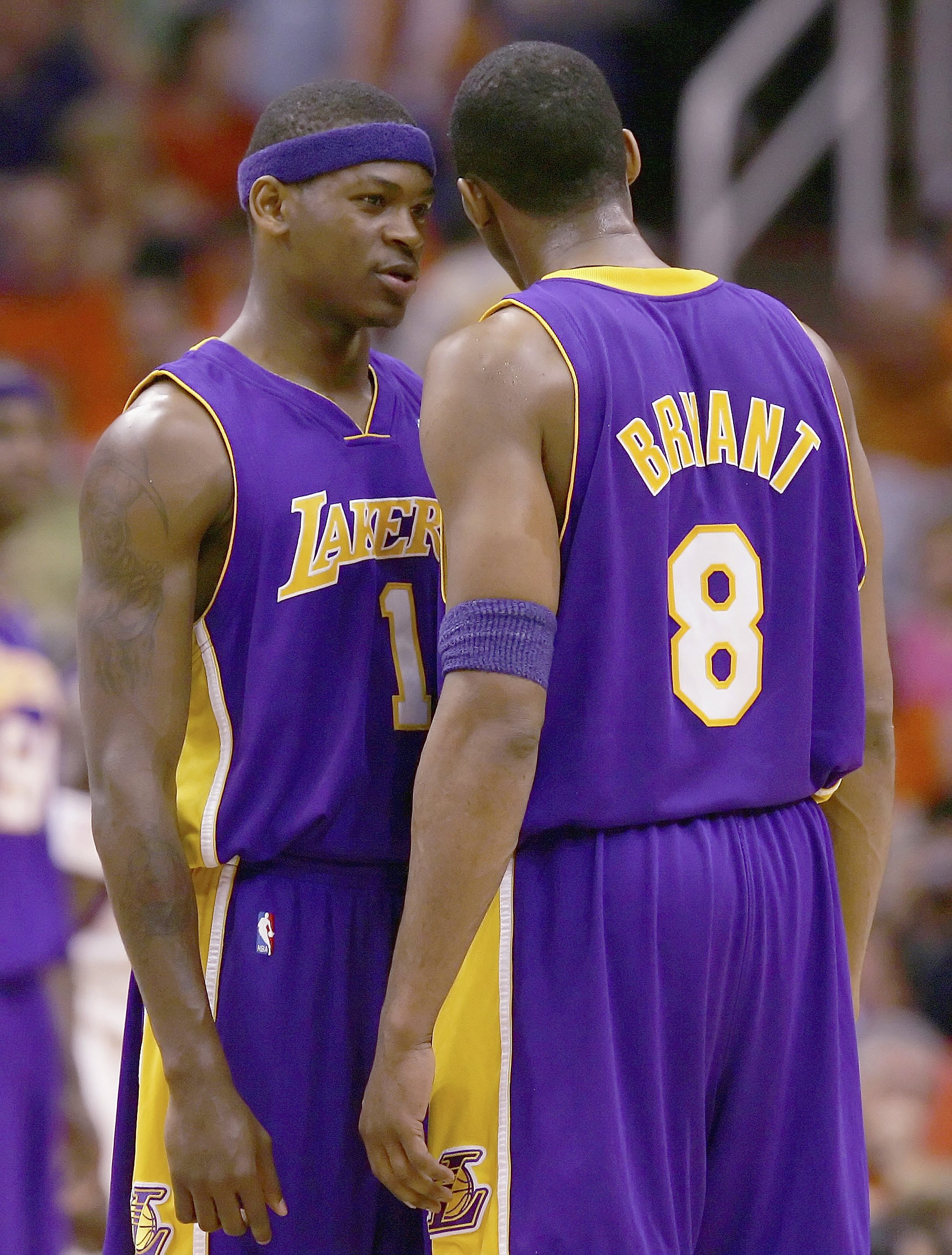 PHOENIX - APRIL 23:  Smush Parker #1 and Kobe Bryant #8 of the Los Angeles Lakers talk during a free throw in game one of the Western Conference Quarterfinals against the Phoenix Suns during the 2006 NBA Playoffs on April 23, 2006 at US Airways Arena in P