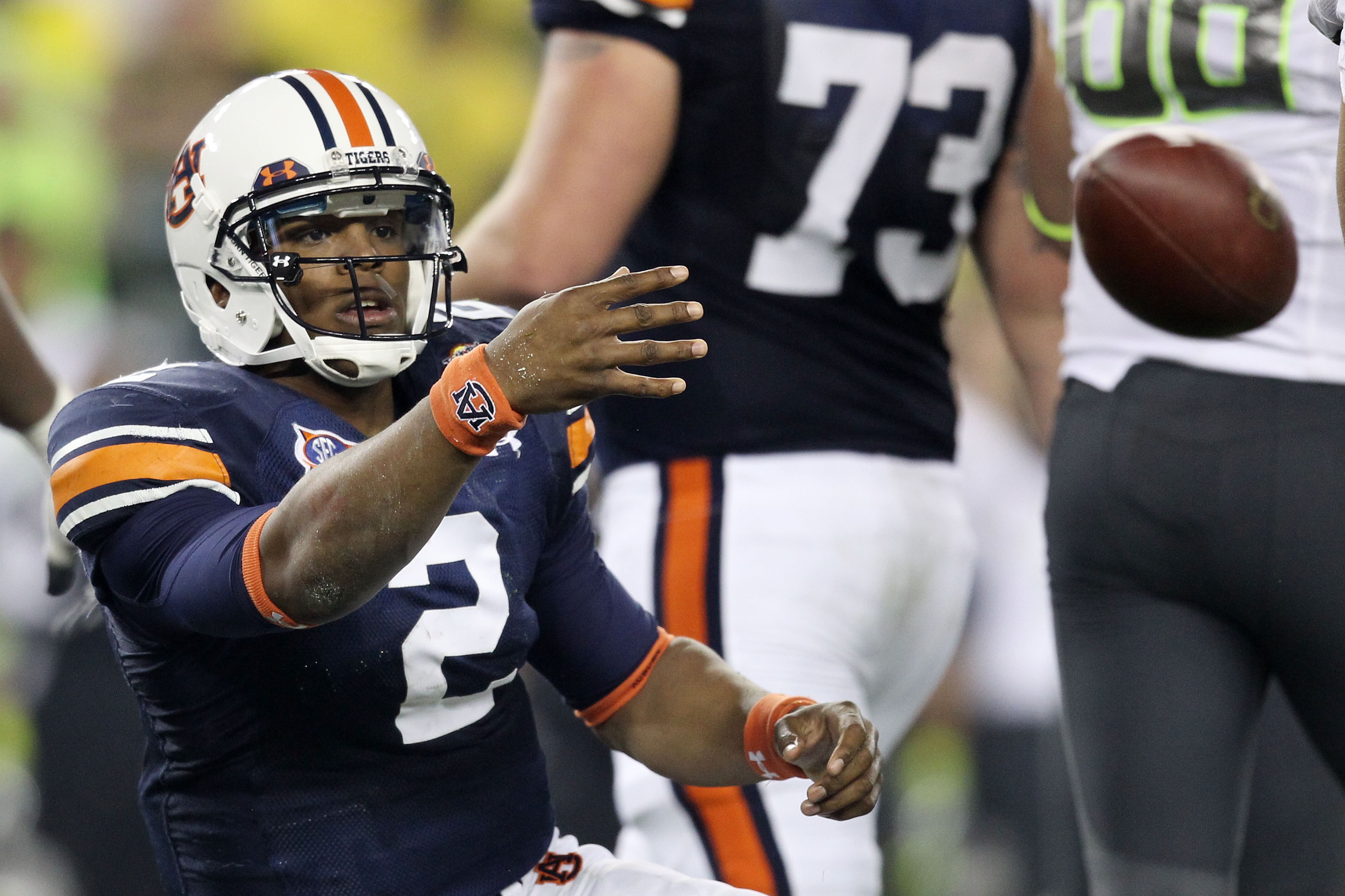 GLENDALE, AZ - JANUARY 10:  Cameron Newton #2 of the Auburn Tigers tosses the ball after being sacked by the Oregon Ducks during the Tostitos BCS National Championship Game at University of Phoenix Stadium on January 10, 2011 in Glendale, Arizona.  (Photo