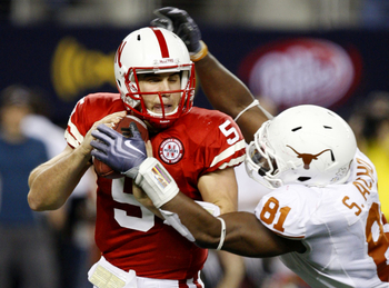 ARLINGTON, TX - DECEMBER 5: Quarterback Zac Lee of the Nebraska Cornhuskers is sacked by Sam Acho #81 of the Texas Longhorns at Cowboys Stadium on December 5, 2009 in Arlington, Texas.  (Photo by Ronald Martinez/Getty Images)