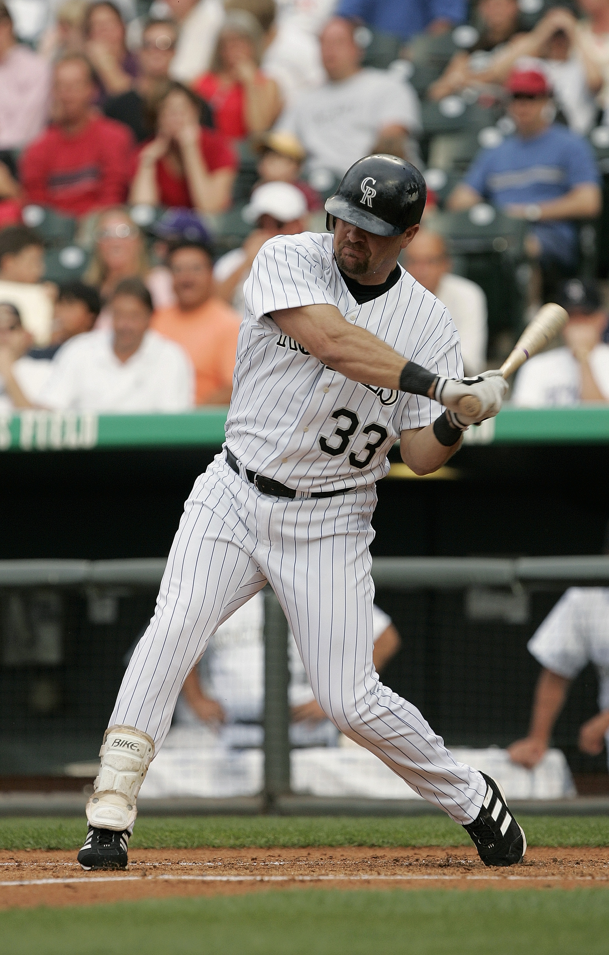 DENVER - JULY 3:  Outfielder Larry Walker #33 of the Colorado Rockies swings at a Detroit Tigers pitch during the interleague game at Coors Field on July 3, 2004 in Denver, Colorado.  The Rockies defeated the Tigers 11-6.  (Photo by Brian Bahr/Getty Image