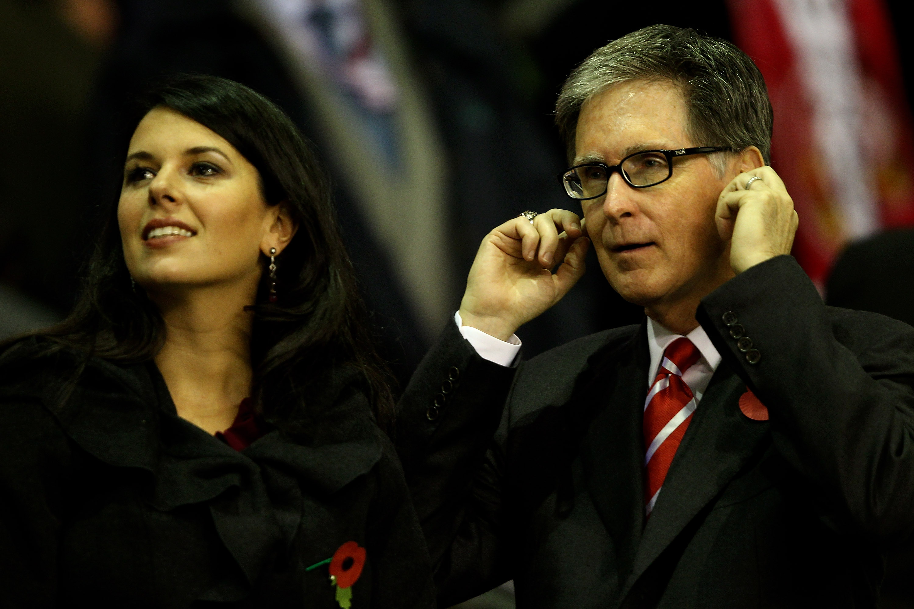 LIVERPOOL, ENGLAND - NOVEMBER 04:  Liverpool Owner John Henry stands with Wife Linda Pizzuti  prior to the UEFA Europa League Group K match beteween Liverpool and SSC Napoli at Anfield on November 4, 2010 in Liverpool, England.  (Photo by Clive Brunskill/