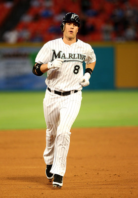 MIAMI GARDENS, FL - APRIL 25:  Chris Coghlan #8 of the Florida Marlins rounds second after hitting a solo HR during a game against the Los Angeles Dodgers at Sun Life Stadium on April 25, 2011 in Miami Gardens, Florida.  (Photo by Mike Ehrmann/Getty Image
