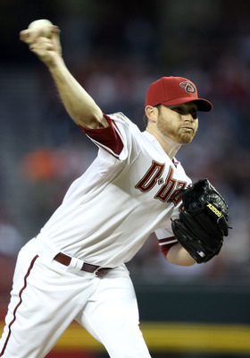 PHOENIX, AZ - APRIL 08:  Starting pitcher Ian Kennedy #31 of the Arizona Diamondbacks pitches against the Cincinnati Reds  during the Major League Baseball home opening game at Chase Field on April 8, 2011 in Phoenix, Arizona. The Diamondbacks defeated th