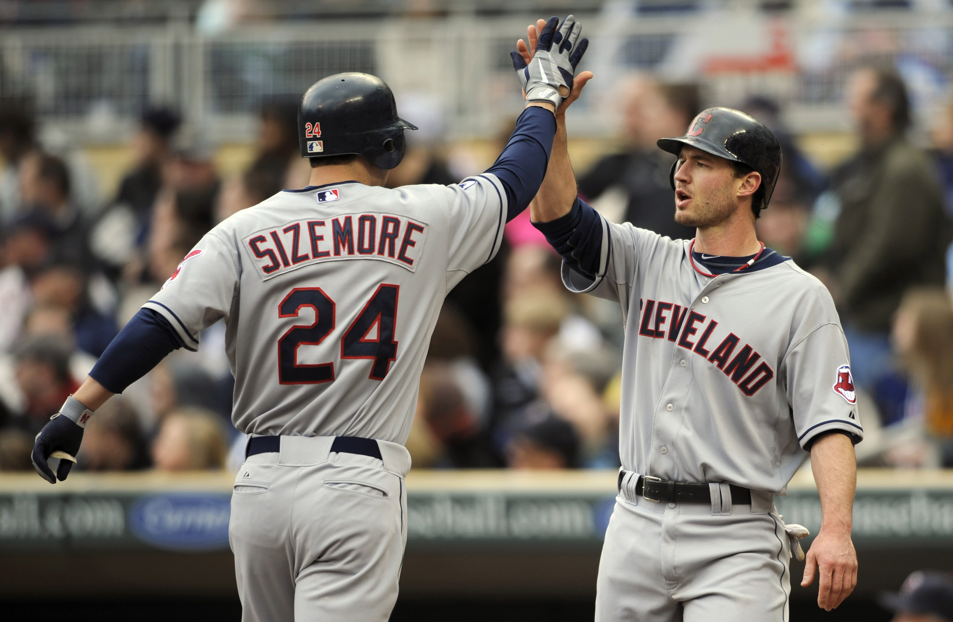 MINNEAPOLIS, MN - APRIL 23: Grady Sizemore #24 and Jack Hannahan #9 of the Cleveland Indians celebrate a two-run home run by Sizemore against the Minnesota Twins during the eighth inning of their game on April 23, 2011 at Target Field in Minneapolis, Minn