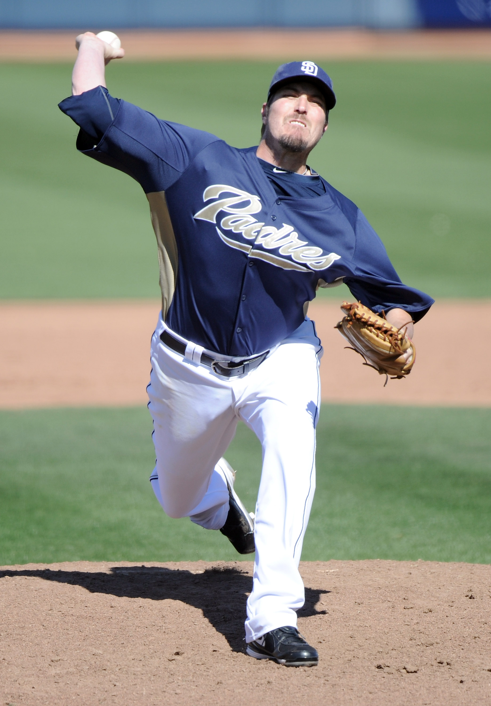 PEORIA, AZ - MARCH 02:  Chad Qualls #52 of the  San Diego Padres pitches against the Colorado Rockies during spring training at Peoria Stadium on March 2, 2011 in Peoria, Arizona.  (Photo by Harry How/Getty Images)