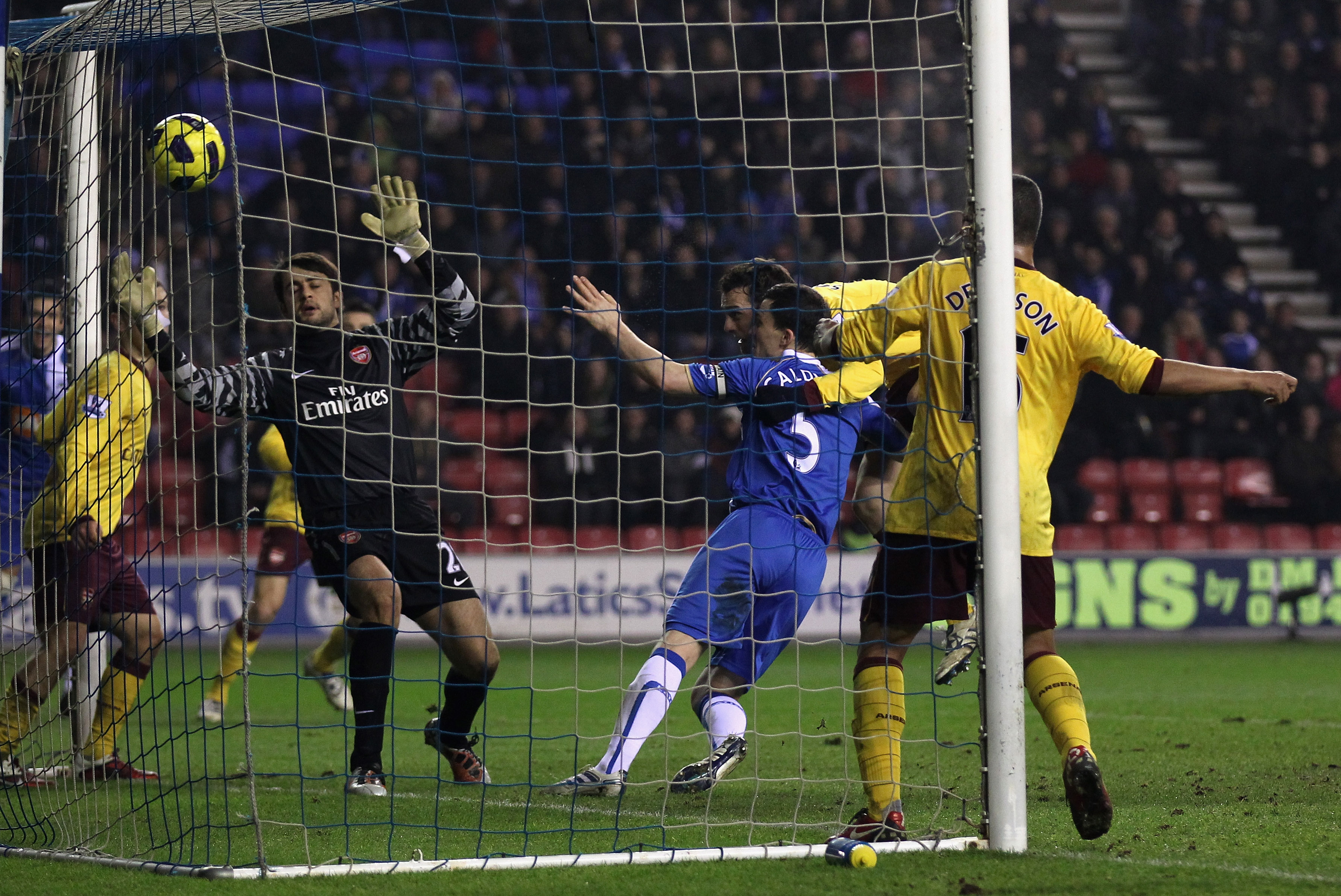 WIGAN, ENGLAND - DECEMBER 29:  Sebastien Squillaci of Arsenal scores an own goal to level the scores during the Barclays Premier League match between Wigan Athletic and Arsenal at DW Stadium on December 29, 2010 in Wigan, England.  (Photo by Alex Livesey/