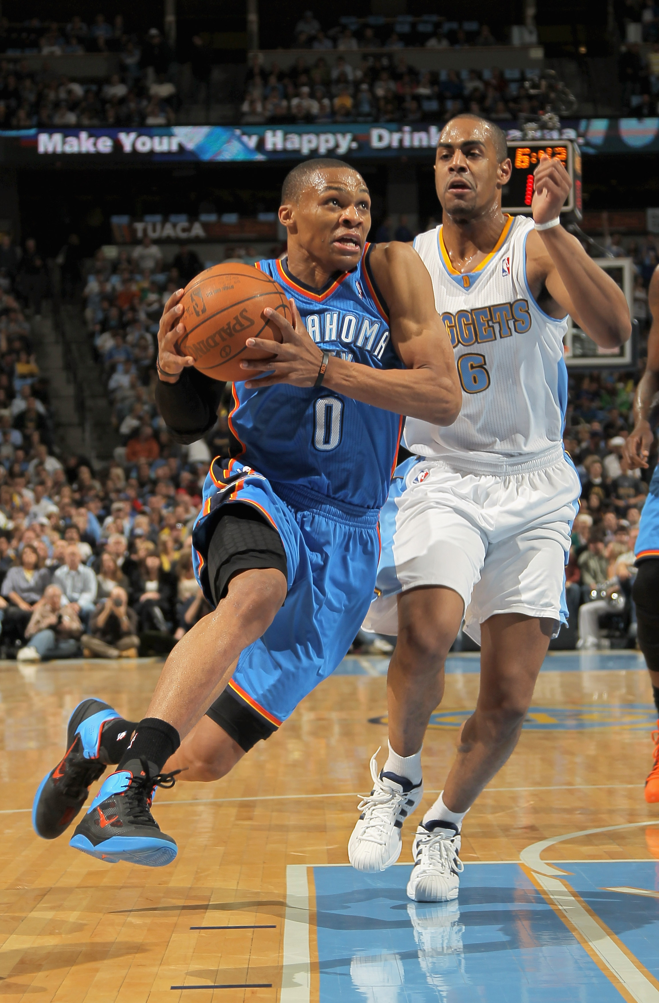 DENVER, CO - APRIL 25:  Russell Westbrook #0 of the Oklahoma City Thunder drives past Arron Afflalo #6 of the Denver Nuggets in Game Four of the Western Conference Quarterfinals in the 2011 NBA Playoffs on April 24, 2011 at the Pepsi Center in Denver, Col