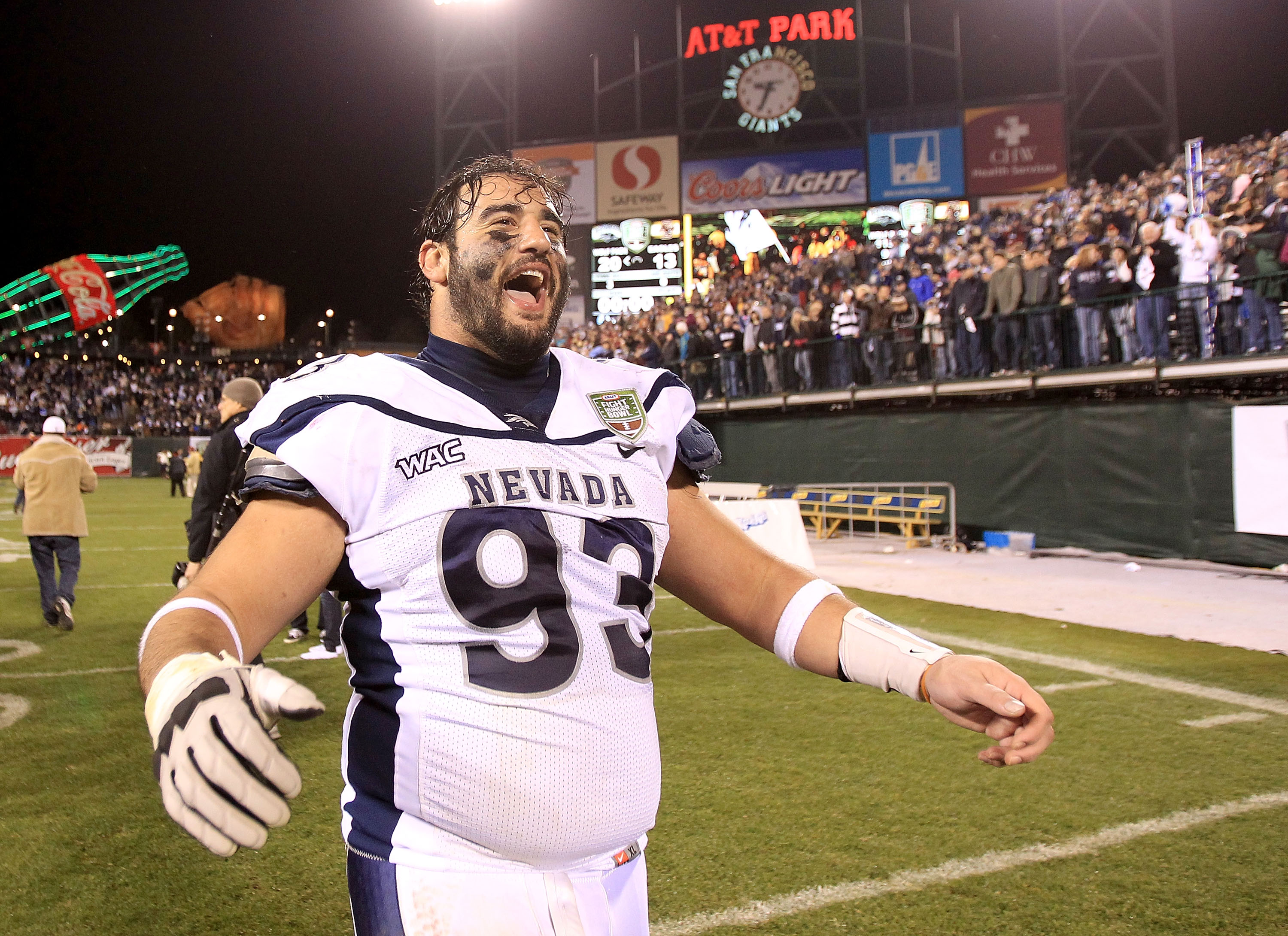 SAN FRANCISCO, CA - JANUARY 09:  Zack Madonick #93 of the Nevada Wolf Pack celebrates after beating Boston College in the Kraft Fight Hunger Bowl at AT&T Park on January 9, 2011 in San Francisco, California.  (Photo by Ezra Shaw/Getty Images)