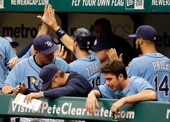 ST. PETERSBURG, FL - MAY 01:  Infielder Ben Zobrist #18 of the Tampa Bay Rays is congratulated by his teammates after scoring a run against the Los Angeles Angels of Anaheim during the game at Tropicana Field on May 1, 2011 in St. Petersburg, Florida.  (P