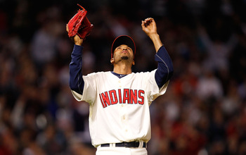 CLEVELAND - APRIL 30:  Rafael Perez #53 of the Cleveland Indians celebrates after completing an inning against the Detroit Tigers during the game on April 30, 2011 at Progressive Field in Cleveland, Ohio.  (Photo by Jared Wickerham/Getty Images)